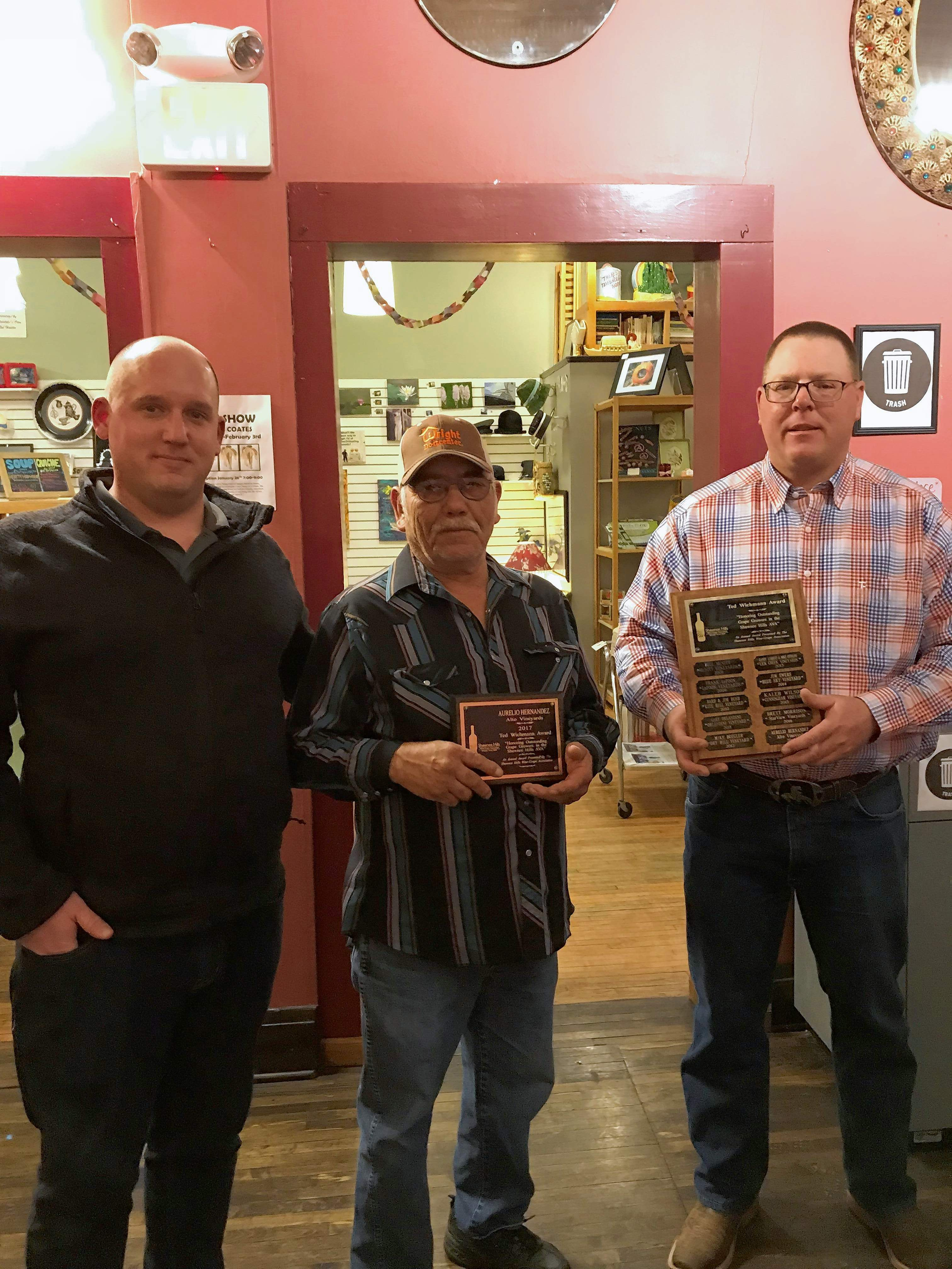 Aurelio Hernendez of Alto Vineyards was honored last week with the Ted Wichmann Grape Grower of the Year Award. Pictured left to right are Scott Albert of Kite Hill Vineyards, Hernandez, and Bill McNitt of McNitt Growers.
