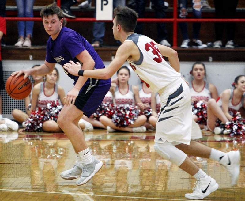 Harrisburg senior guard Carson Burtis had a team-high 14 points in the Bulldogs' 60-57 road win at West Frankfort Friday night.