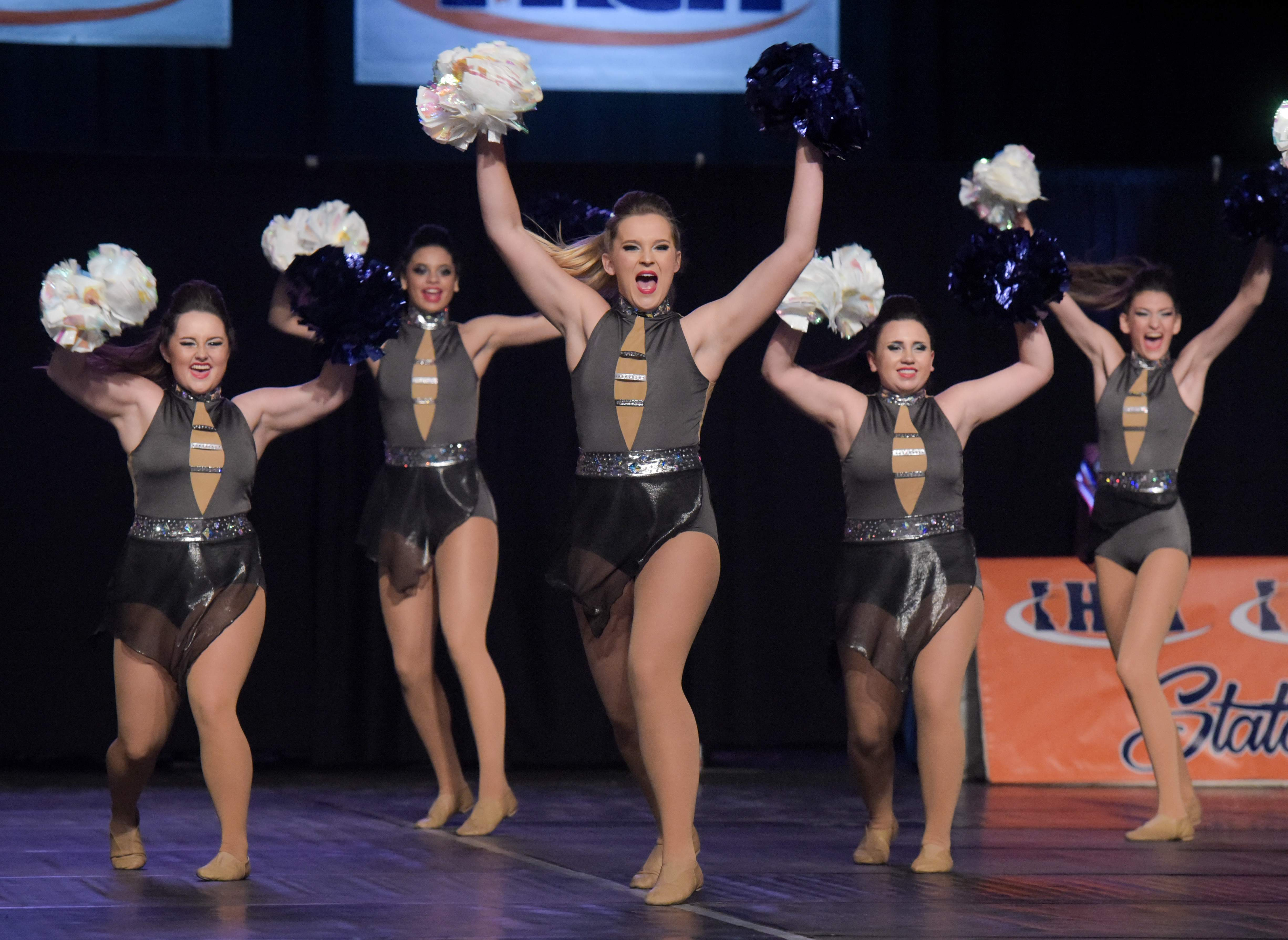 The Murphysboro High School competitive dance team does their routine inside the Grossinger Motors Arena in Bloomington.