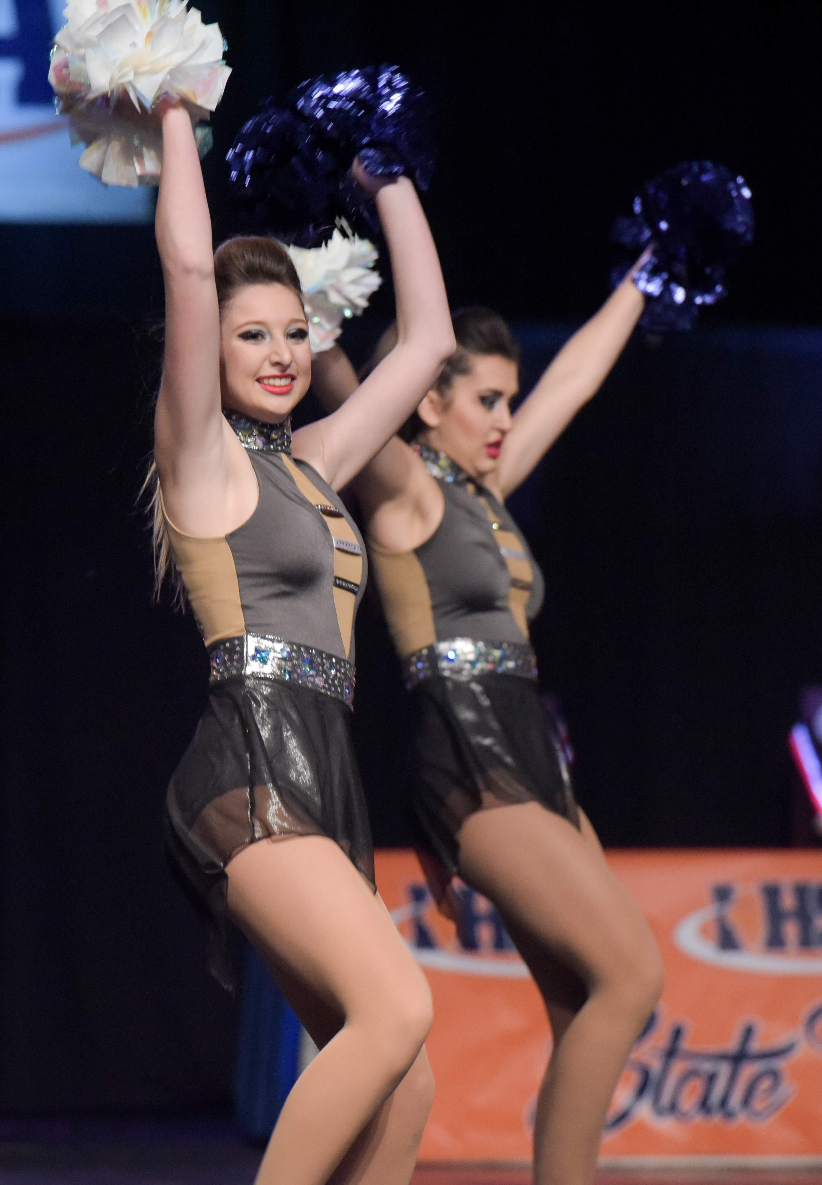 Jenna Leaton and Rachel Finders perform with the team on Friday.