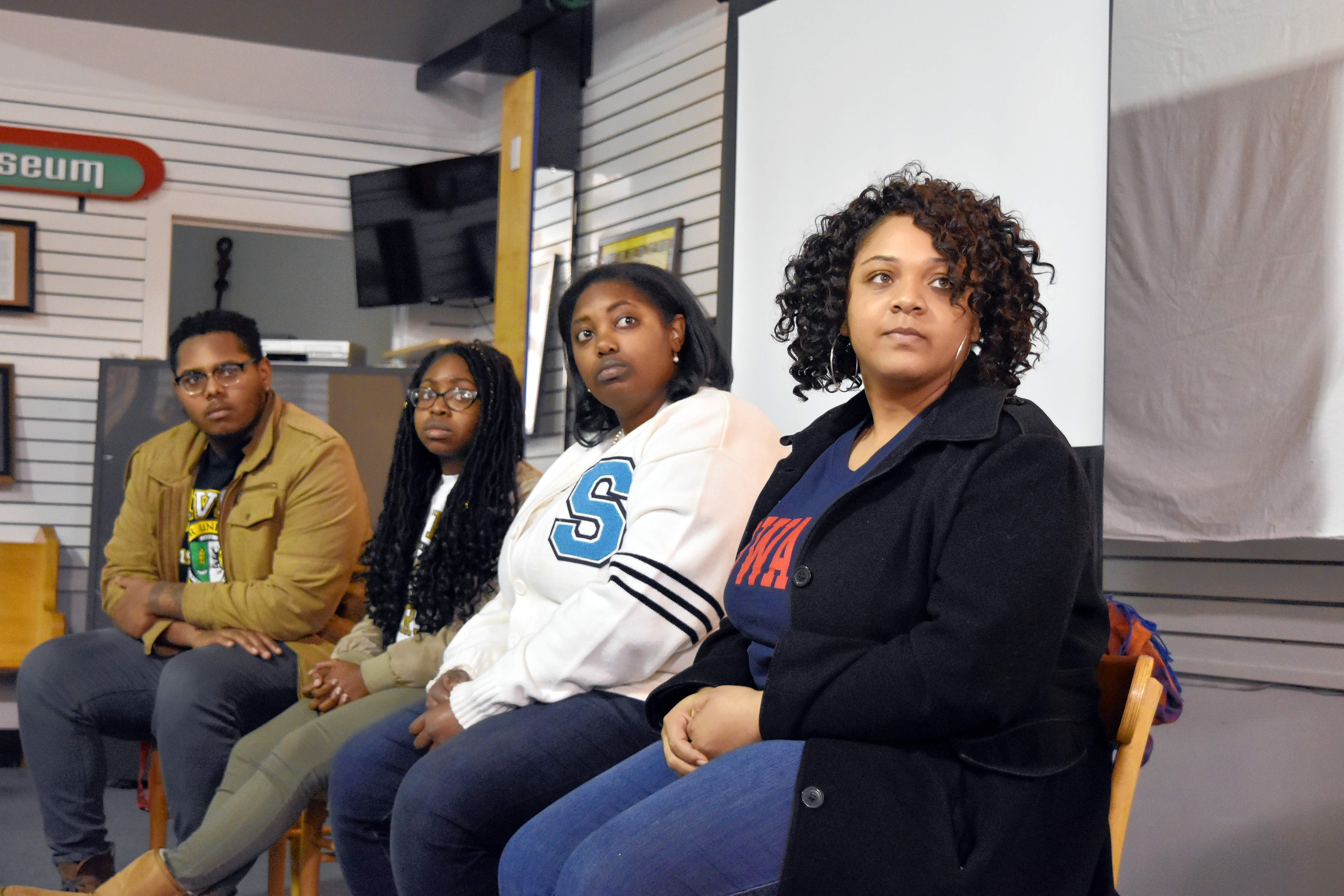 """Pictured are, from left, Kendale Watson (Xavier University of Louisiana), Cheron Perkins (Xavier University of Louisiana), Jasmine Bryant (Spelman College) and Stephanie Wooten (Howard University) as they listen to moderator Dr. Pamela Smoot (not pictured) during a panel discussion after a screening of the film """"Tell Them We Are Rising: The Story of Black Colleges and Universities"""" on Thursday at University Mall. The four all attended historically black colleges and universities (HBCUs)."""