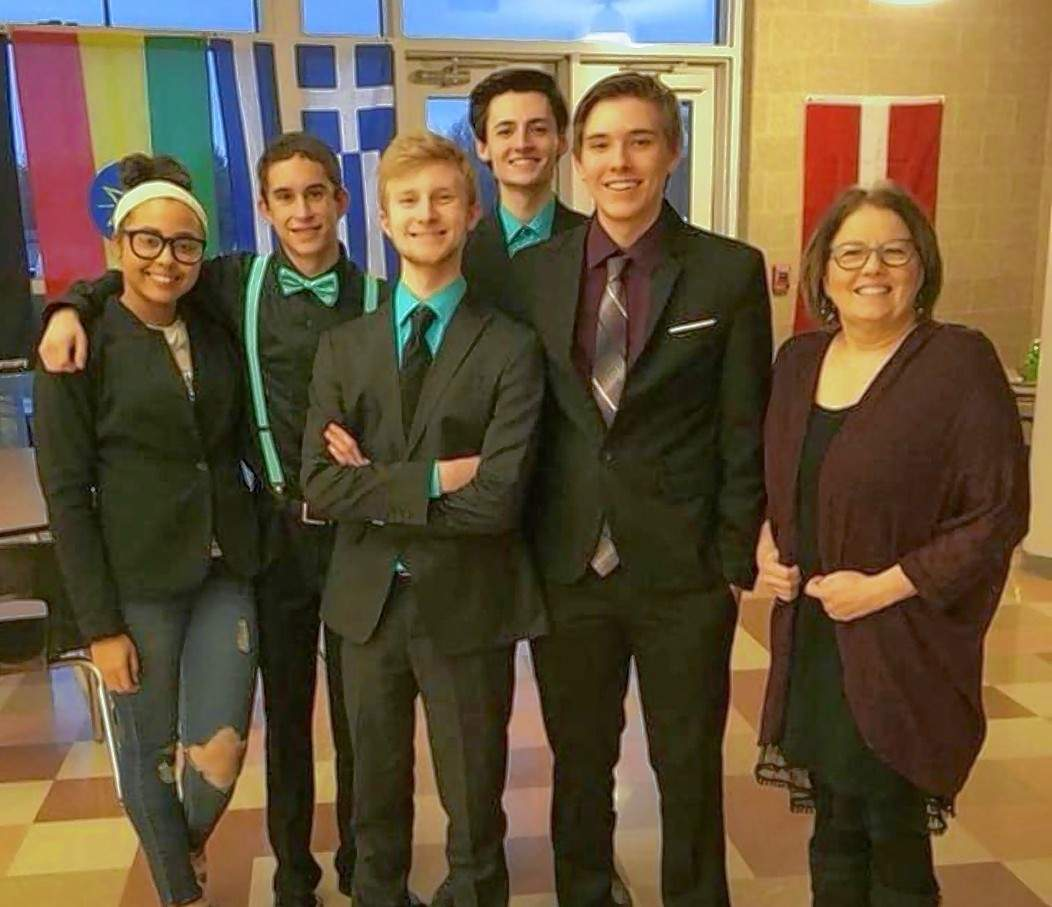 Team members Desirae Jones, Kyle Bristow, Kale Rister, Billy Lewis and Alex Peebels are pictured with their coach, Carla Kirkland.