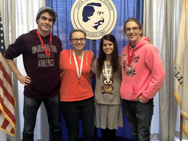 Pictured are, from left, Du Quoin High School students Paxton Higgerson, Delainey File, Emily Hamburger and Nathan Manning after competing in the Worldwide Youth in Science and Engineering (WYSE) competition on Feb. 9 at John A. Logan College. Higgerson took second in Computer Science, File placed third in English, Manning took second in Physics and Hamburger placed third in Math. Higgerson and Manning will compete again at the sectional competition.