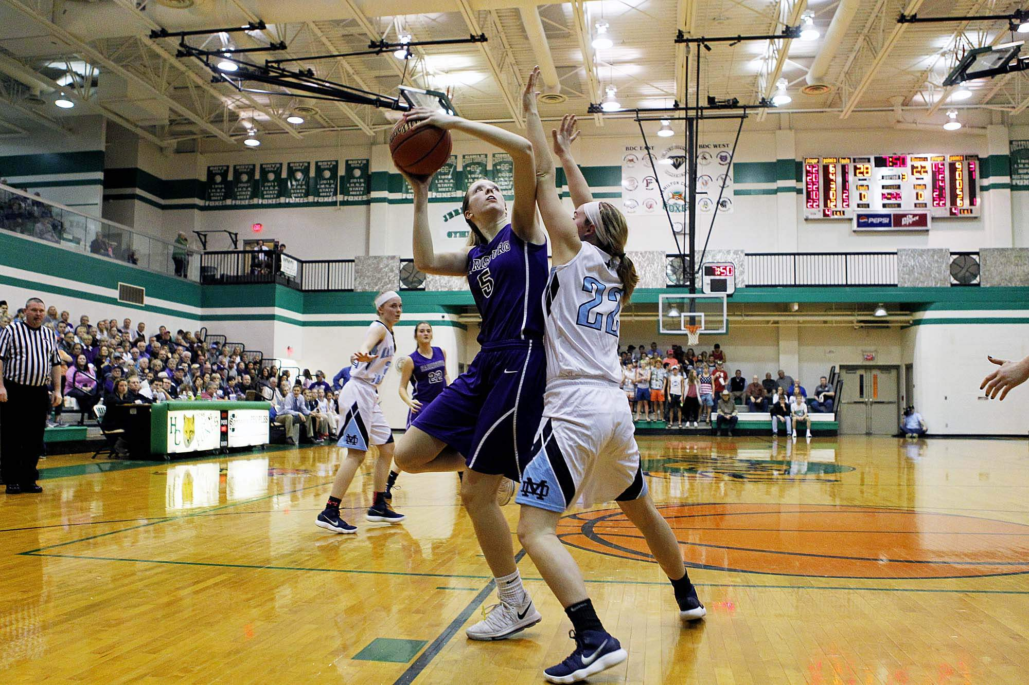 Matty Hawkins puts up this second half shot against Breese Mater Dei's Myah Beckman. Hawkins had a team-high 13 points for the Bulldogs in a 55-44 loss