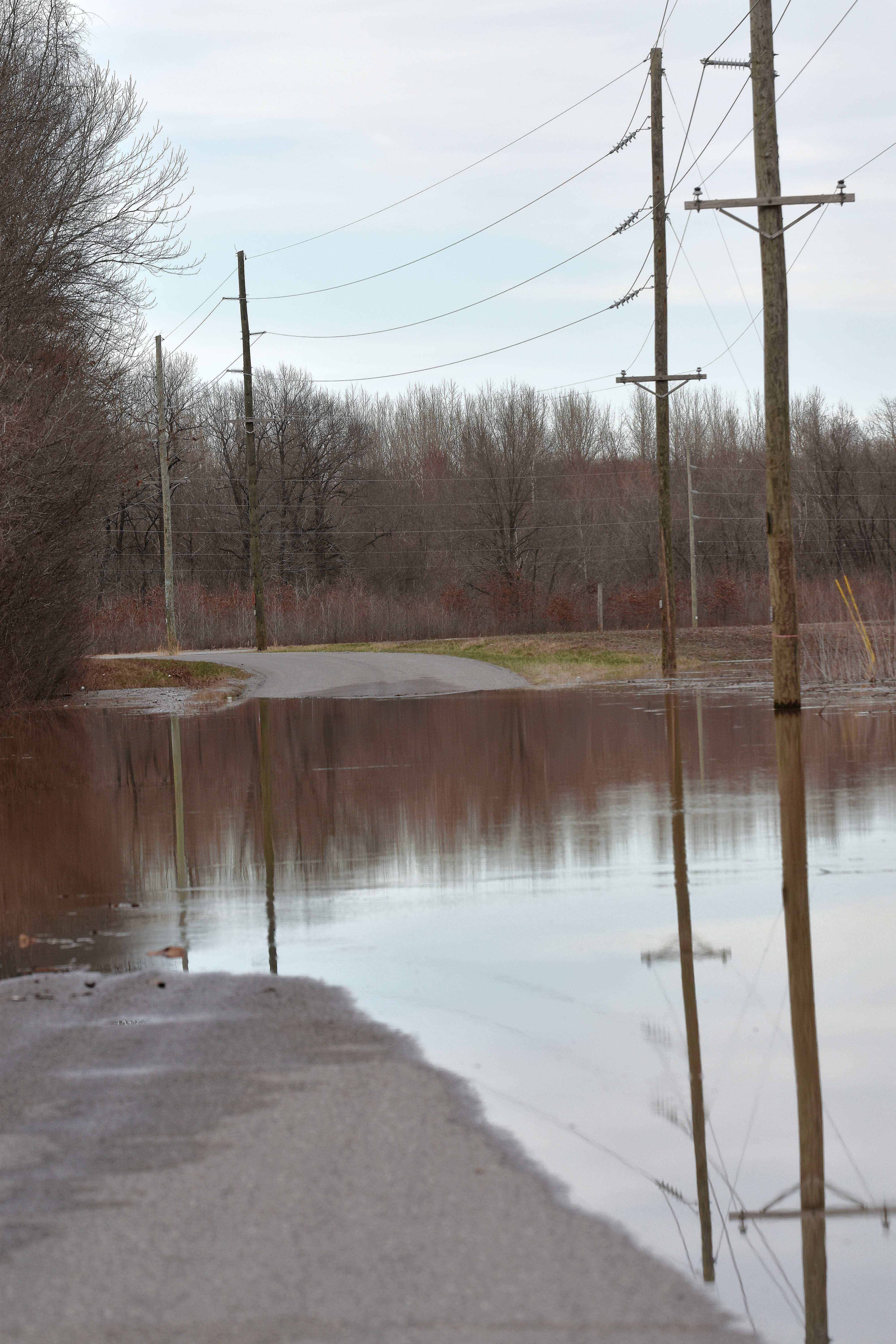 Water covers a portion of Whitesville Road. Some Saline County roads will be covered with water as the Ohio River continues to rise through Sunday. Motorists are urged not to attempt to drive through flooded roads.