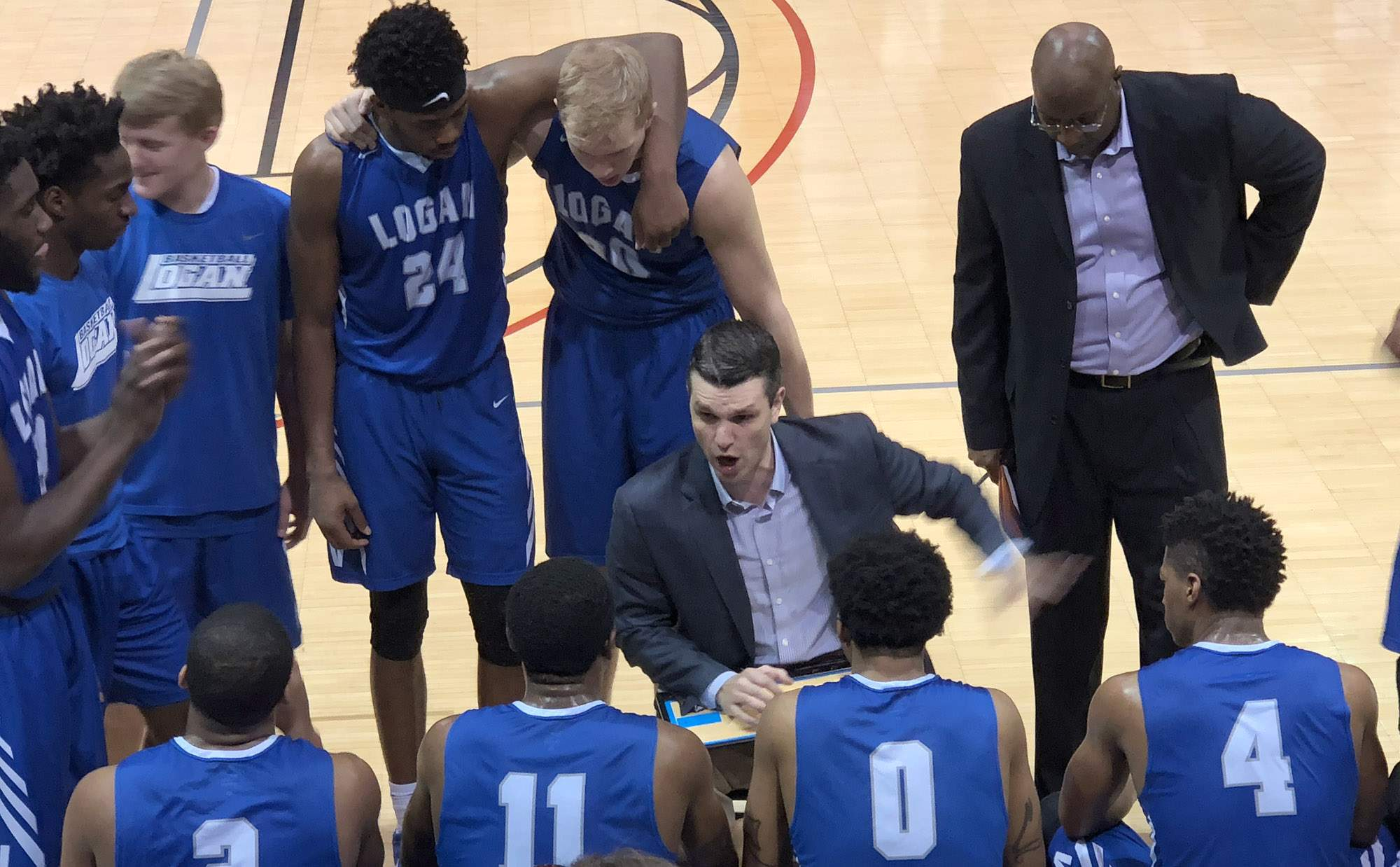 Logan head coach Kyle Smithpeters talks during a timeout Tuesday night at Wabash Valley College.
