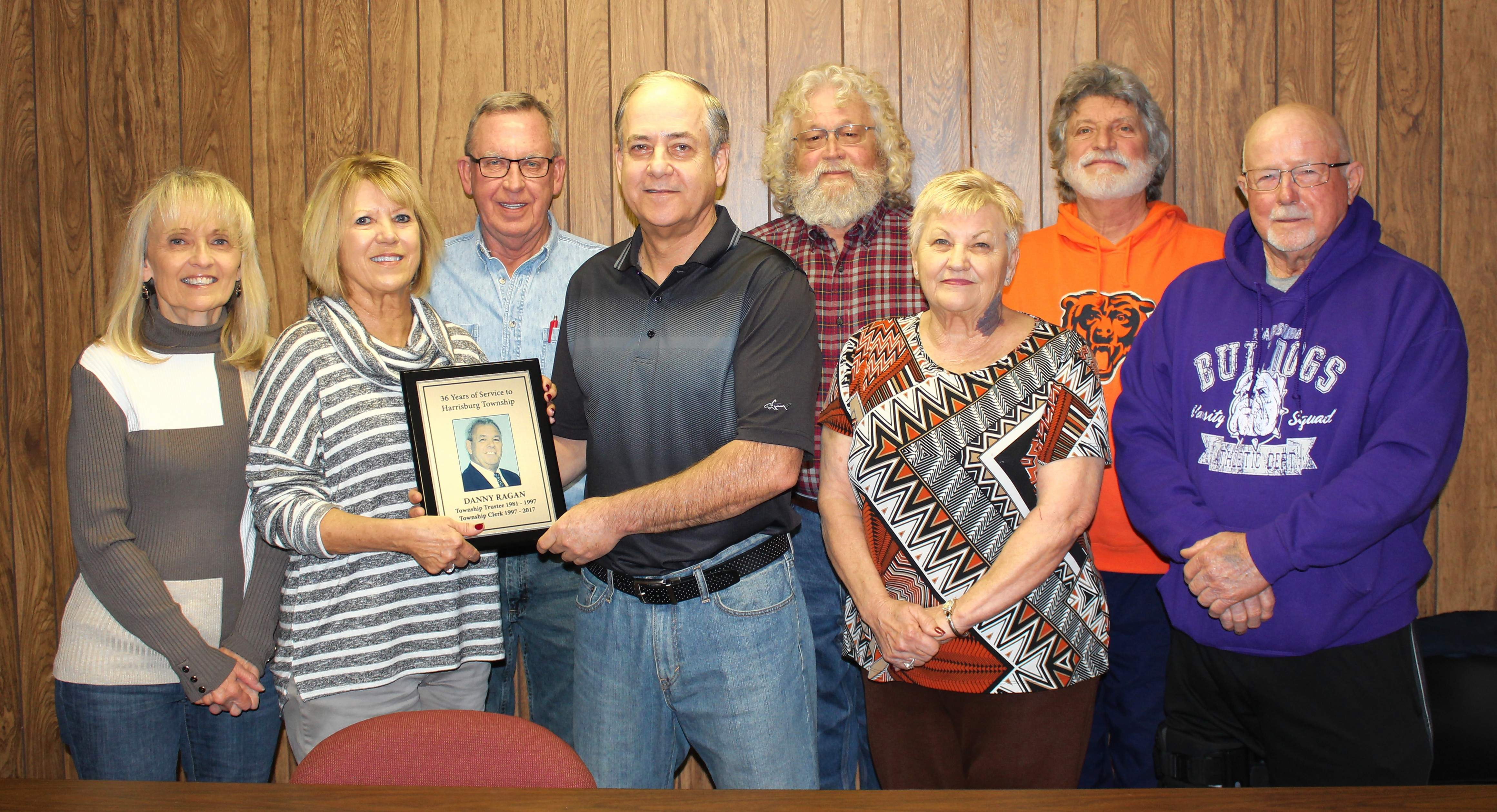 Harrisburg Township officials recently presented a plaque honoring the late Danny Ragan's 36 years of service to the township to his wife Kathy Ragan. From left are Township Assessor Elaine Clayton , Kathy Ragan, trustee Steve Horn, Township Supervisor Danny Clayton, trustee Tim Mitchell, trustee Gailene Harrelson, trustee Roger Angelly, and Road Commissioner Bob Holmes.