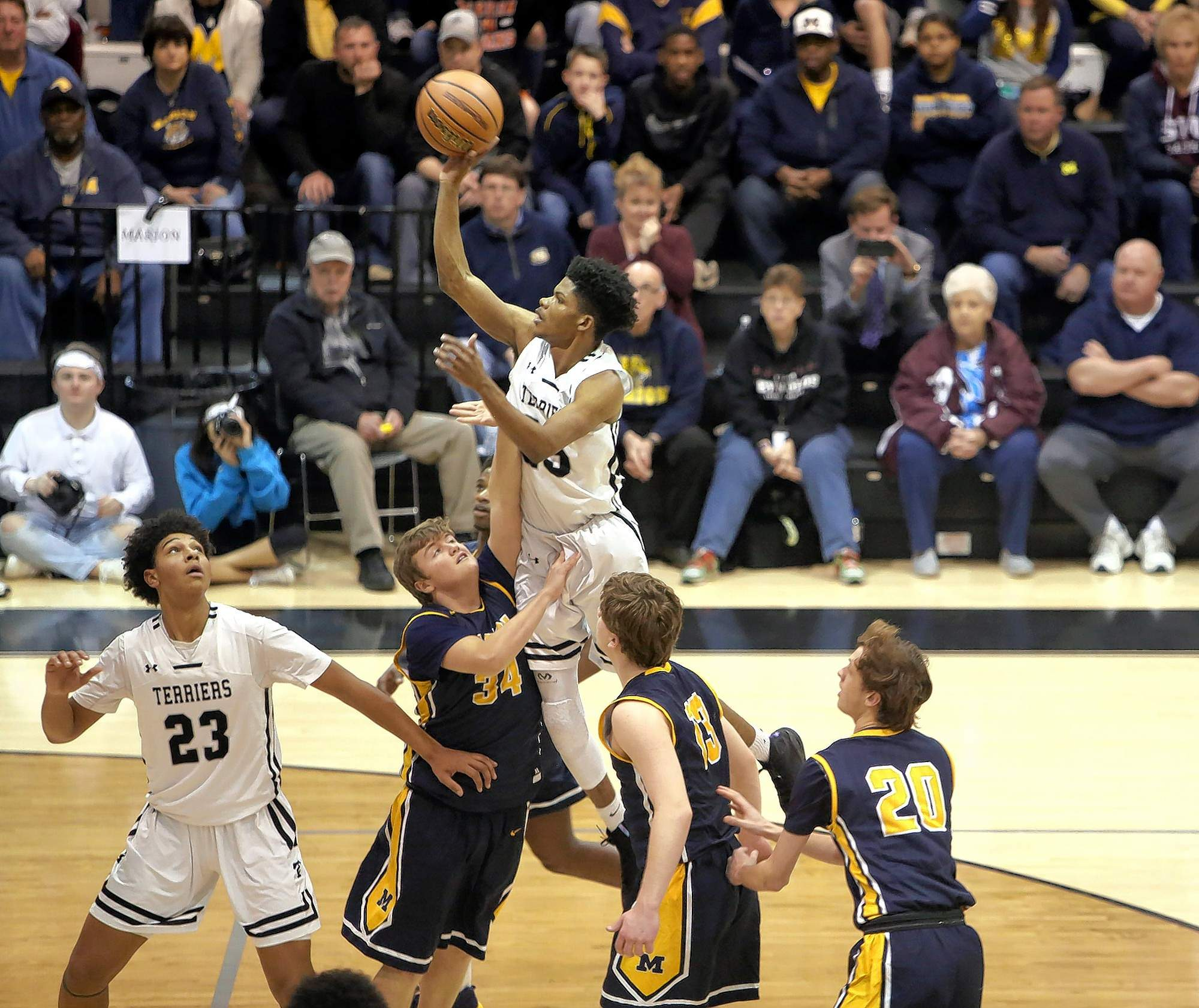 Justin Walker photoCarbondale's Darius Beane puts one up during the Terriers' season-ending loss to Marion Friday night. Beane will go on to play next season for the Salukis.