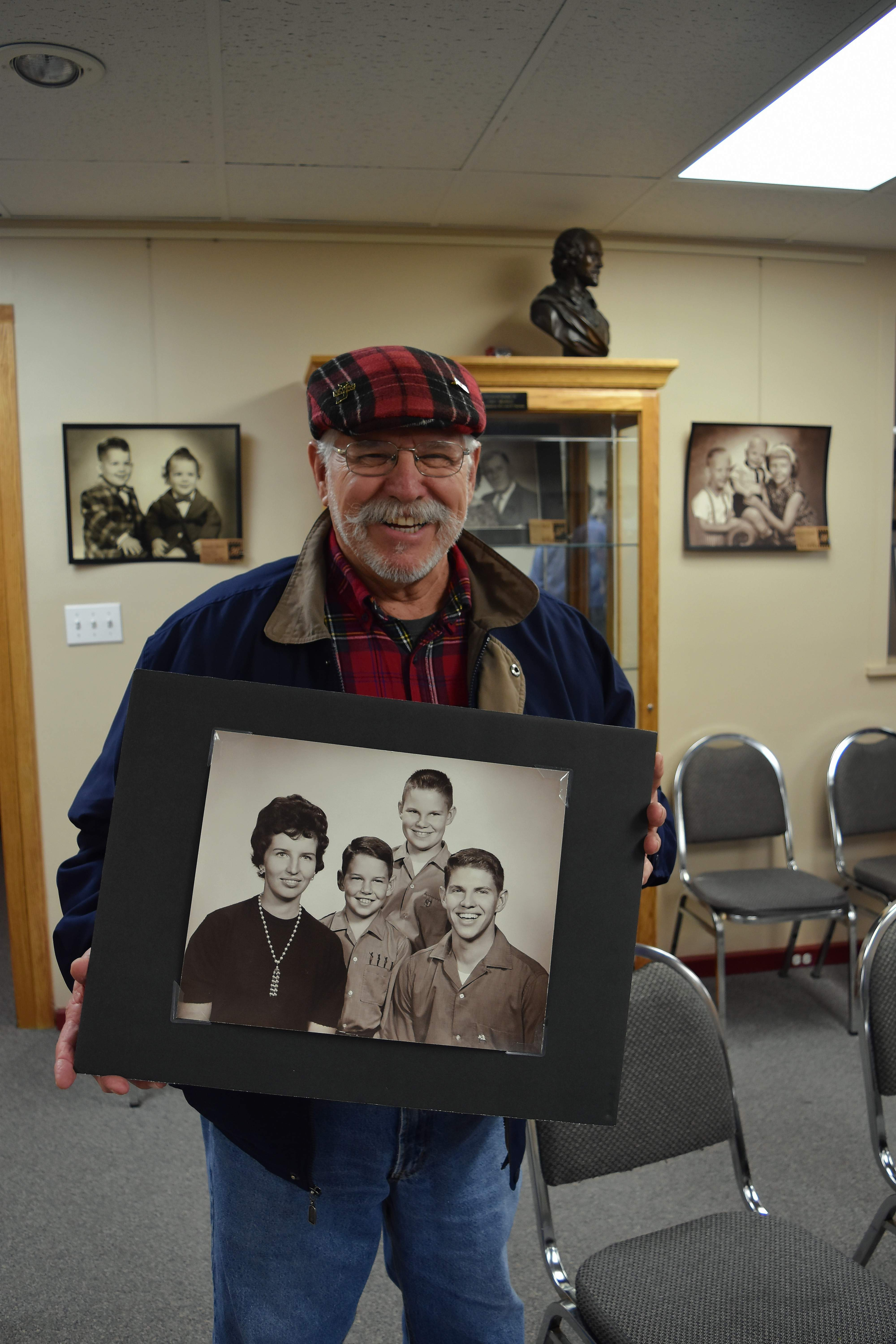 Jim Whyte of Eldorado holds a previously unidentified portrait of himself, on the right in the photo, and his three siblings made in 1960