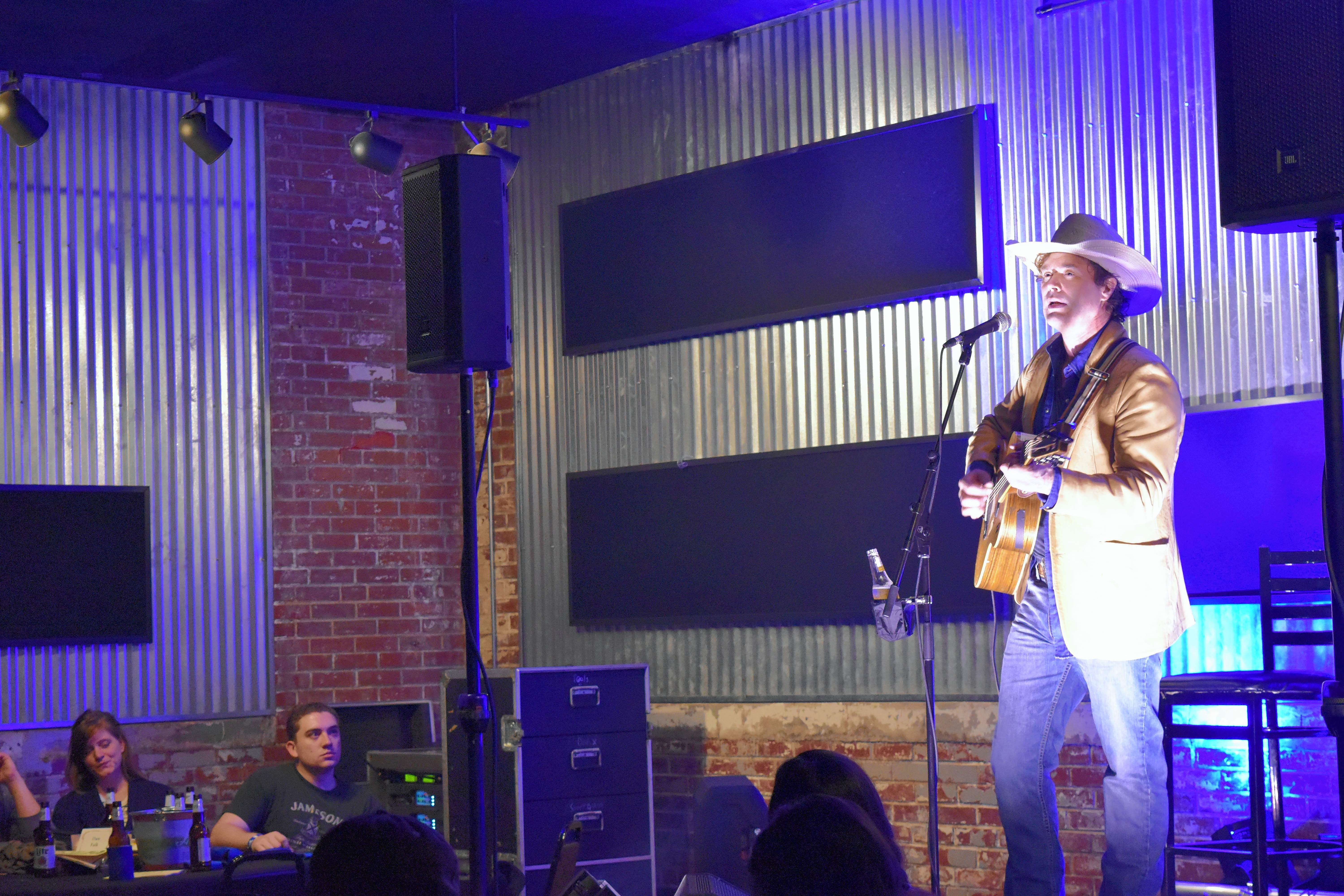 Canadian musician Corb Lund plays to a sold-out crowd in the banquet room at Morello's in Harrisburg Saturday night.