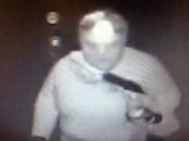 A surveillance camera image from the burglary at Little Chapel Church.