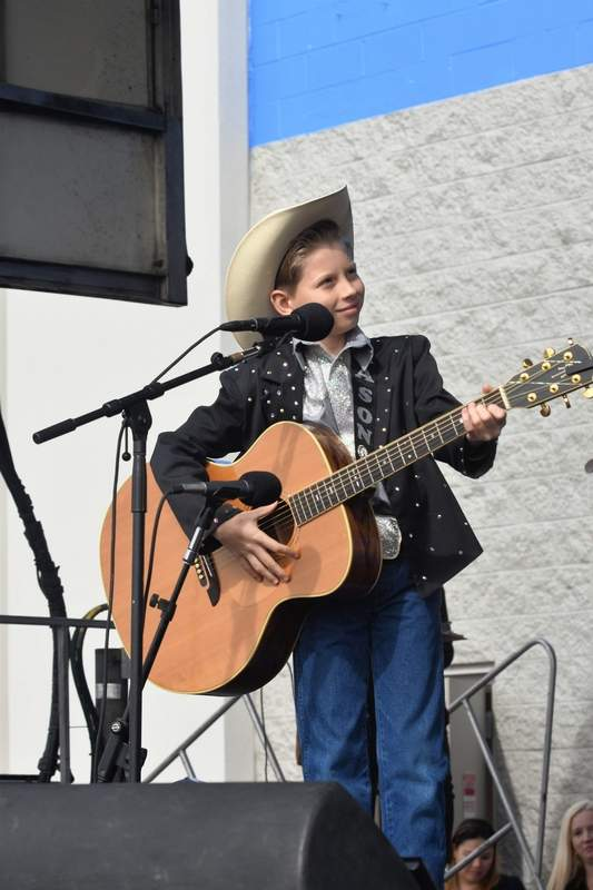 Mason Ramsey of Golconda prepares to perform Wednesday afternoon in his first live concert at the Harrisburg Walmart.
