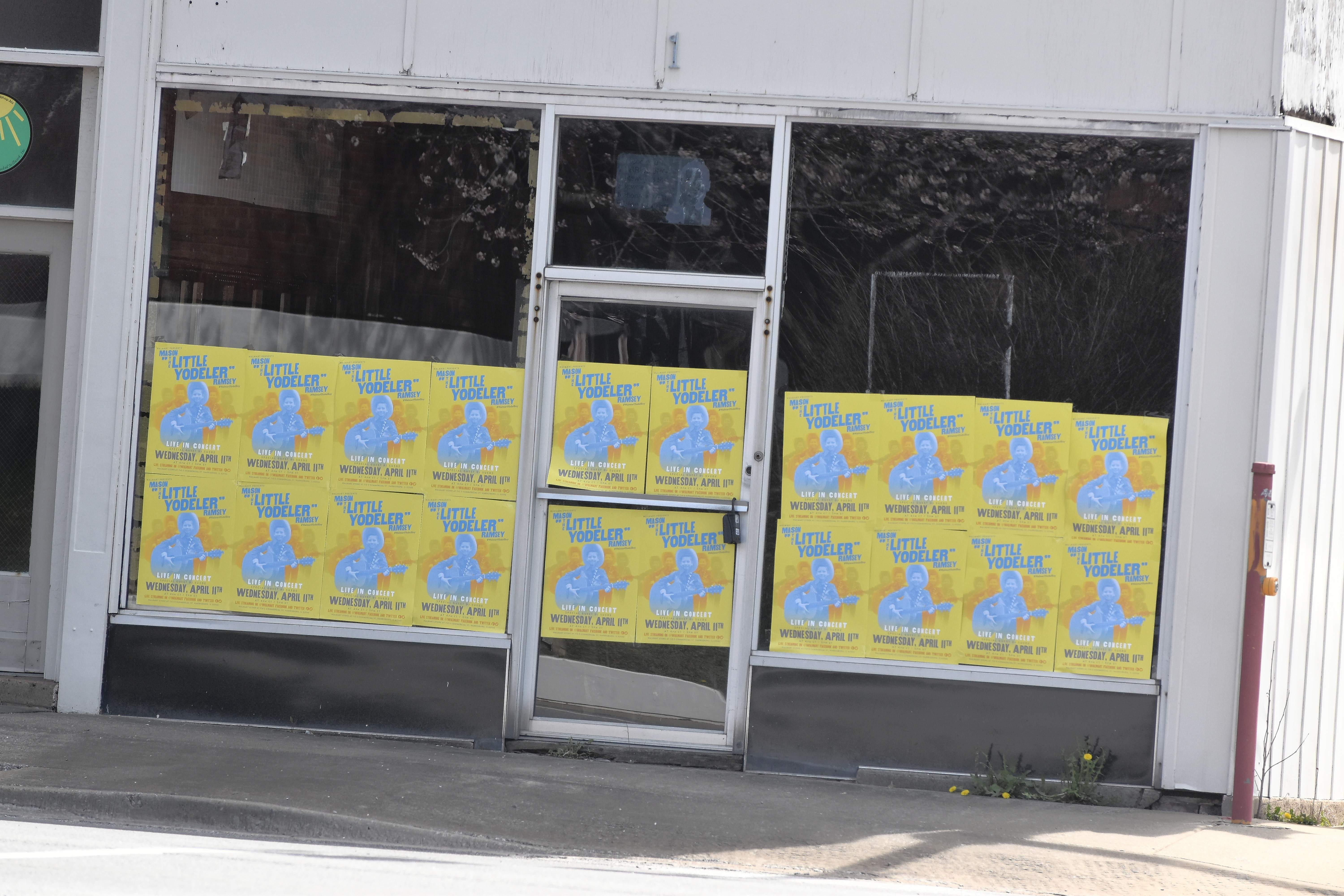 Storefronts with Mason Ramsey posters greet visitors to Harrisburg Wednesday.