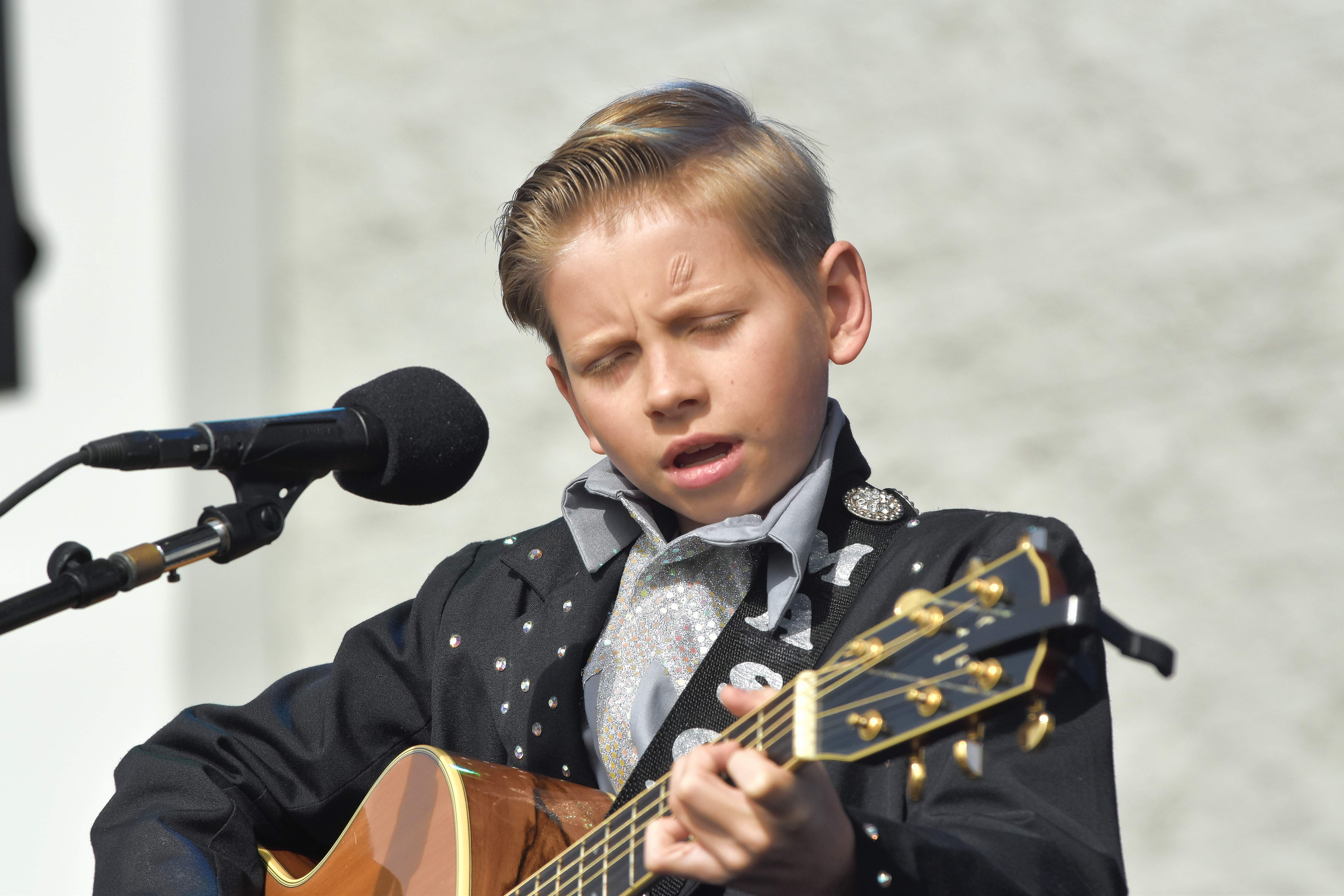 Mason Ramsey performs at his first live concert Wednesday at the Harrisburg Walmart.