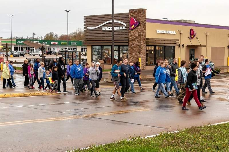 Local residents turned out despite the inclement weather Saturday morning to participate in the first annual autism awareness and fundraising walk sponsored by General Cable of Du Quoin.