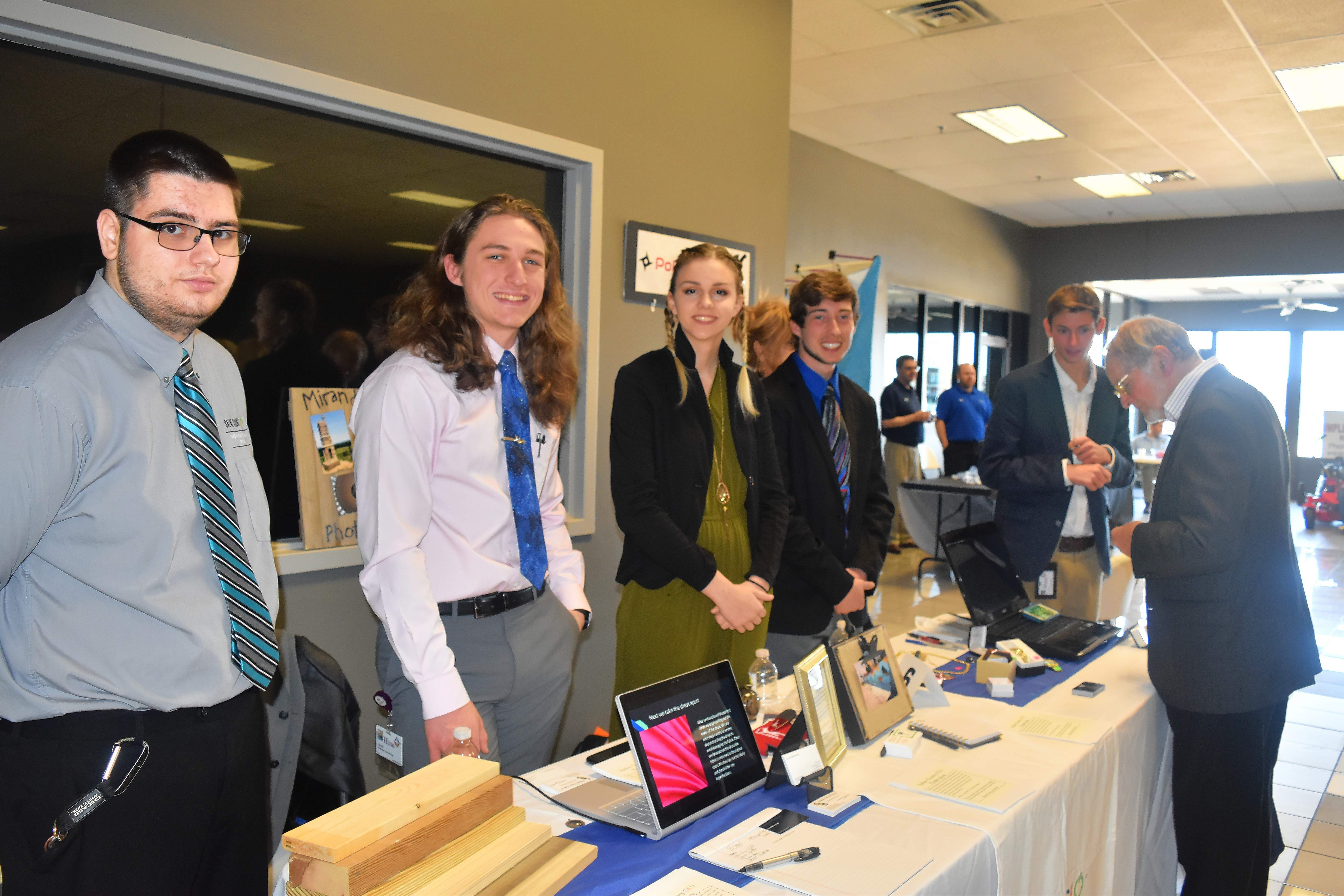 Members of the Saline County CEO group display their businesses at the Business Expo.