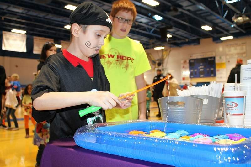 Pirate Gavin Dowdy, 12, of Harrisburg, fishes for prizes during Southeastern Illinois College's Kid's Fair.