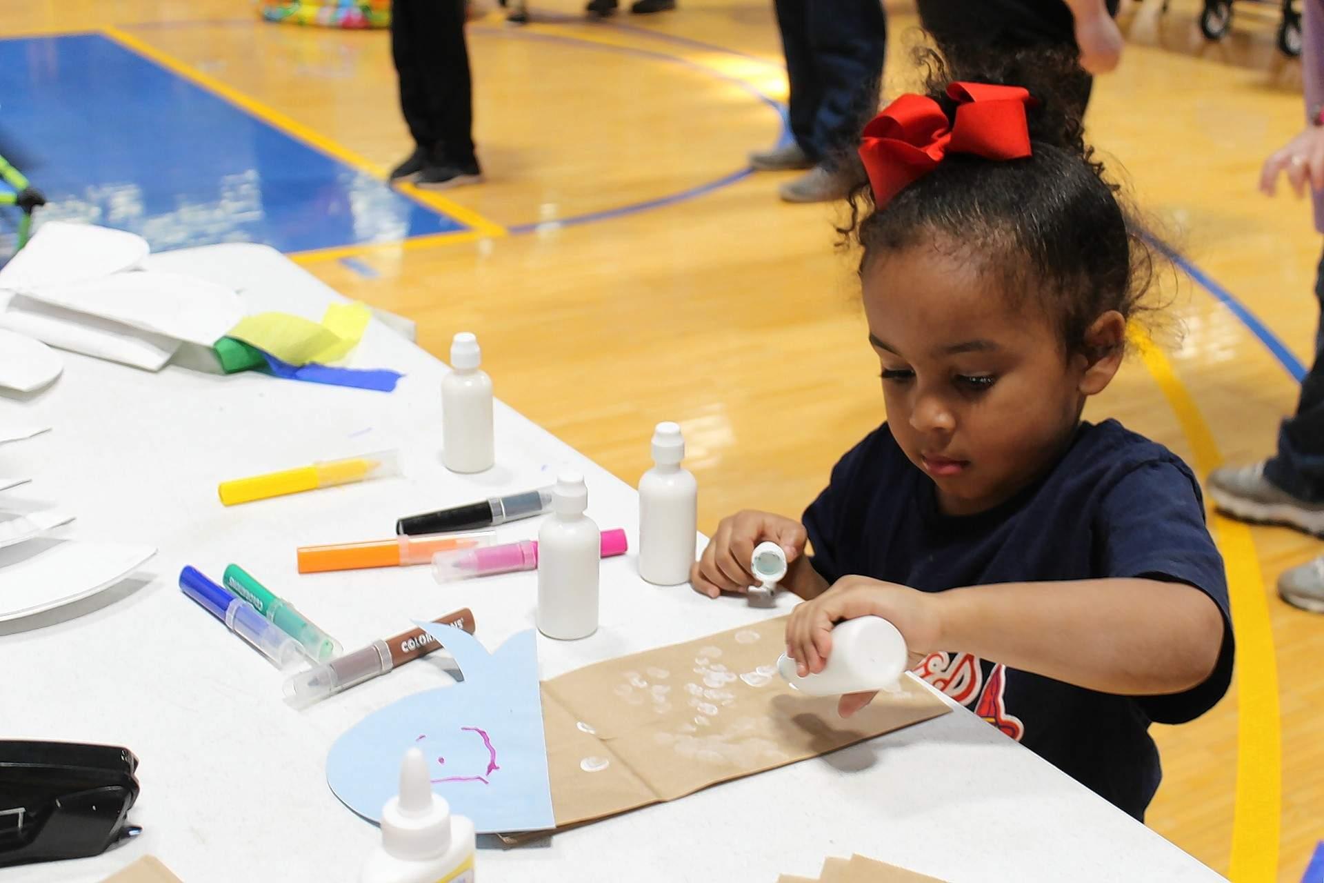Daytyn Moss, 4, of Harrisburg, creates a new hand puppet.
