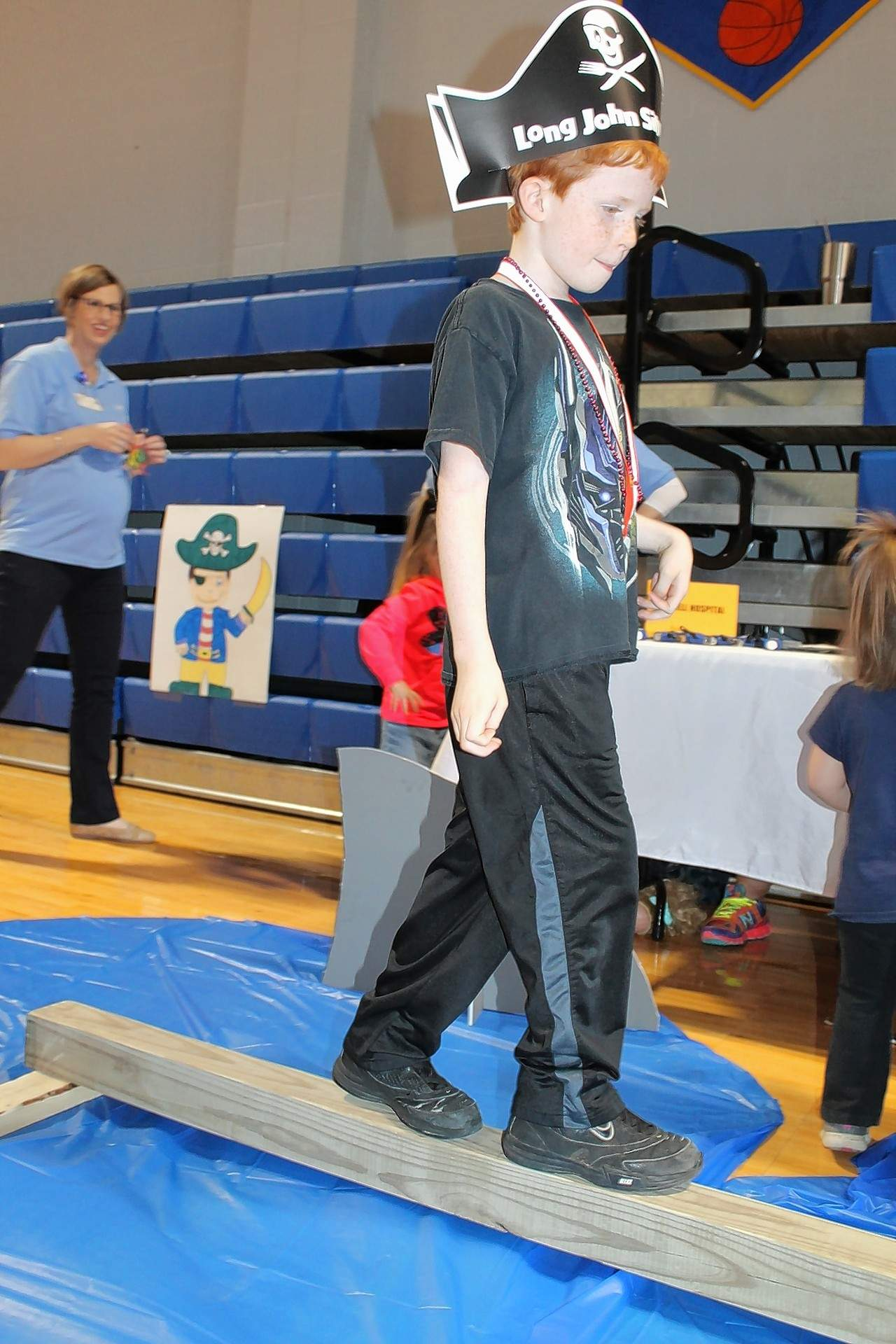 Chase Brown, 8, of Norris City, carefully walks the plank at the Kid's Fair.