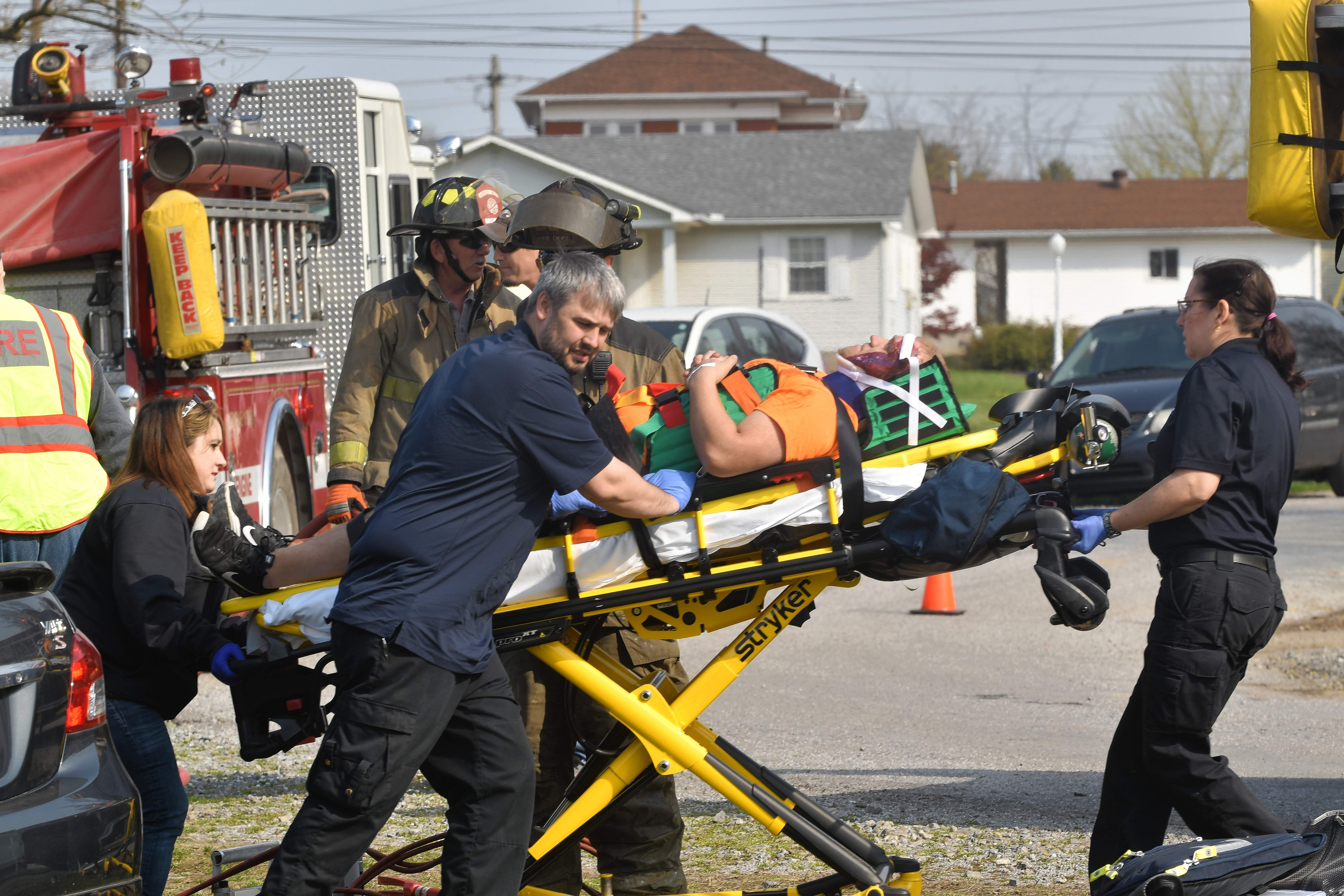 """Air Evac Lifeteam members move a wreck """"victim"""" to the helicopter as part of the mock drill Wednesday morning."""