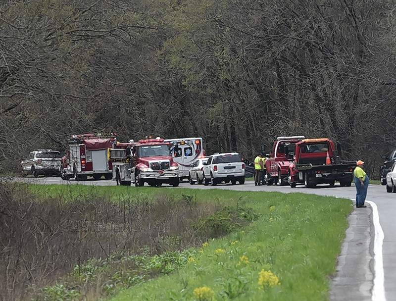 The vehicle in an early Monday afternoon crash is barely visible between emergency vehicles along U.S. 45 south of Carrier Mills.