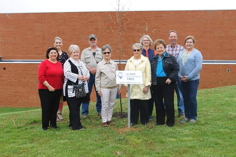 The Eldorado Garden Study Club donates a Illinois Bicentennial Tree to SIC in honor of Arbor Day. From left are Marilyn Ellis, Kyla Burford, associate dean of Student Services, Ellen Butler, Mark Stucker, SIC grounds custodian, Susan Justice, Donna Hearn, Dr. Dana Keating, Dr. Mary Jo Oldham Morgan, Ed Fitzgerald, SIC director of environmental services, and Jan Cleveland, club president.