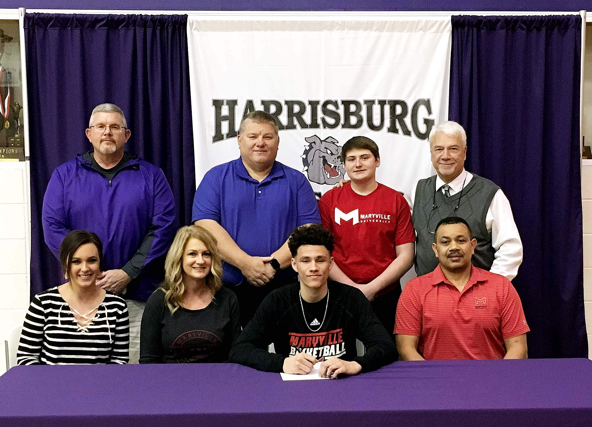 Harrisburg's Isaiah Saulsberry recently signed a National Letter Of Intent to play basketball at Maryville University. Joining Saulsberry at his signing were (front row, from left) Tierra Jones (sister), Joni Saulsberry (Mother), Saulsbery and Patrick Saulsberry(Father). Back row, from left, Greg Langley (athletic director), Richard Dwyer (HHS assistant coach), Jase Leinenbach and Randy Smithpeters (HHS head coach).