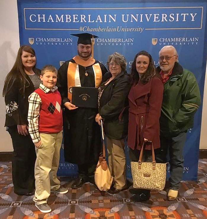 Josh Richardson of Carrier Mills and his family celebrate his graduation from Chamberlain University last month.