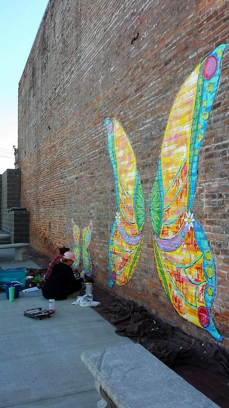 Visitors to the center of Harrisburg likely will notice the large butterfly wings newly painted on the east side of Towne Square Pub.