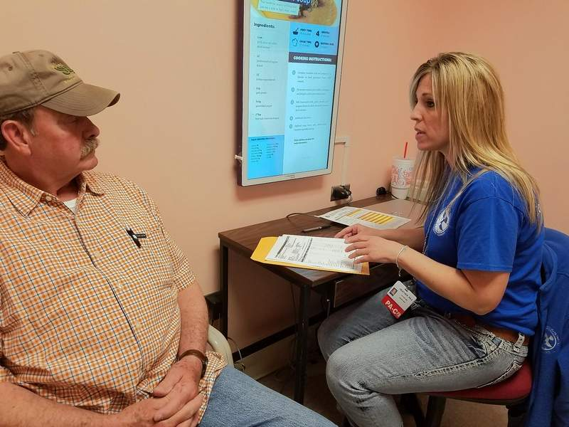 Heather Rice, physician assistant at Marshall Browning Hospital in Du Quoin, reviews lab results with Roy Plumlee of Tamaroa.