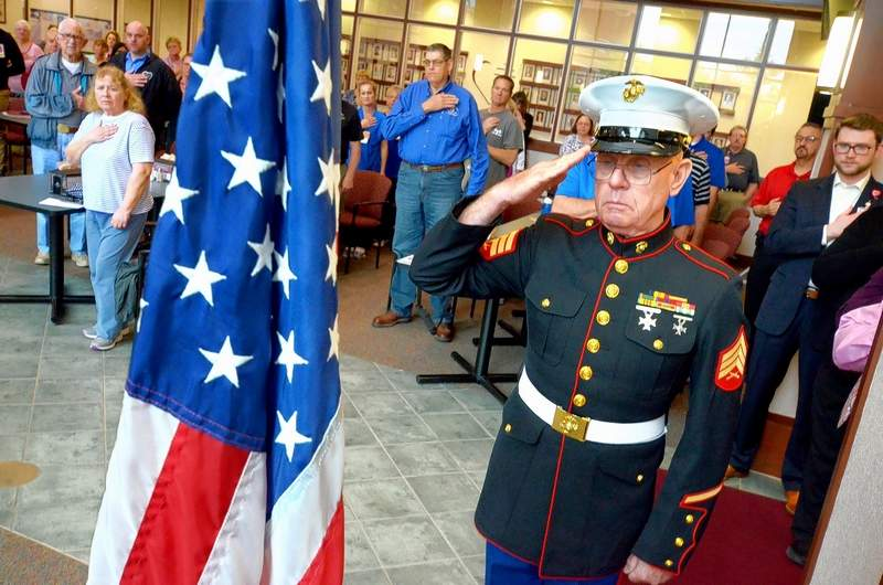 The National Day of Prayer was celebrated locally Thursday at Heartland Regional Medical Center in Marion where a small crowd gathered to pray and sing. Here, Marine veteran Mark Cosgrove presented the American flag and led those in attendance in reciting the Pledge of Allegiance to the flag.