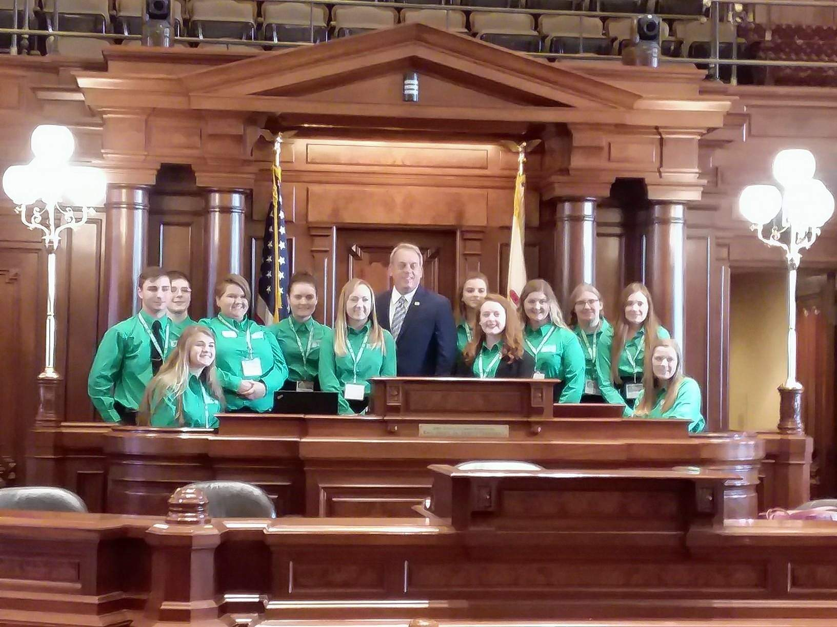 Saline County 4-H members Chloe Hopkins and Christian Jean join 4-H members from across the state at our State Capitol in Springfield for Legislative Connection. 4-H youth attend face-to-face and web trainings to be certified in Speaking for Illinois 4-H prior to their capitol visit.  Pictured are Senator Dale Fowler with 4-H members from his district.