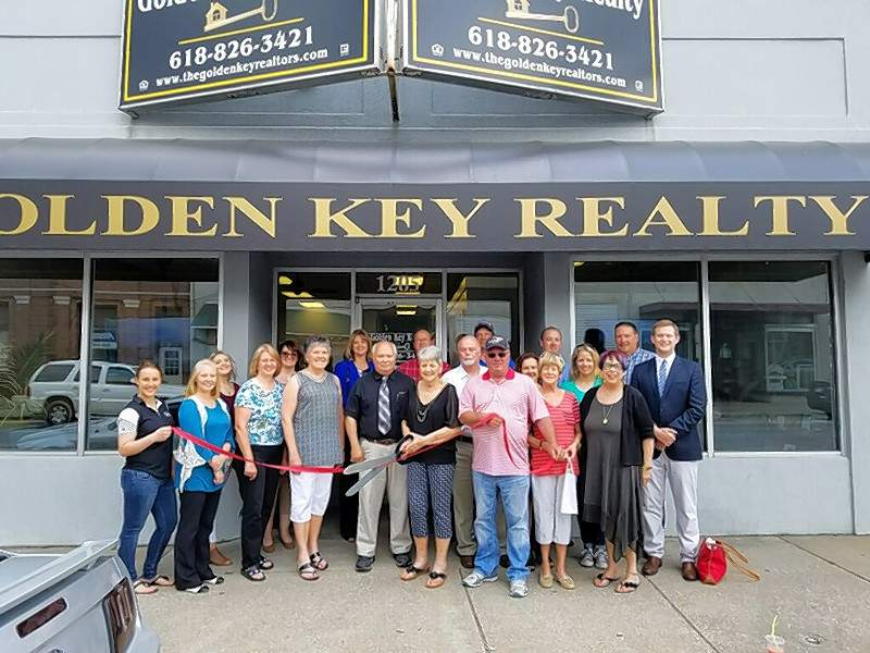 Golden Key Brokers are Dorcus Gruber, Florence Kane, Don Otten, Bonnie Ripperda, John Lane and Bruce Luthy, Sr. Pictured, left to right, Chelsea Schroeder, Diane Hecht, Kraiten Franklin, Bonnie Ripperda, Deb Franklin, Florence Kane, Mary Sulser, Don Otten, Bruce Luthy, Sr., Dorcus Gruber, John Lane, Ron Woodworth, Mayor Tom  Page, Marge Sanders, Linda Sympson, Bruce Luthy, Jr., Andrea Luthy, Gwendy Garner, Dan Colvis and Kris Koeneman.