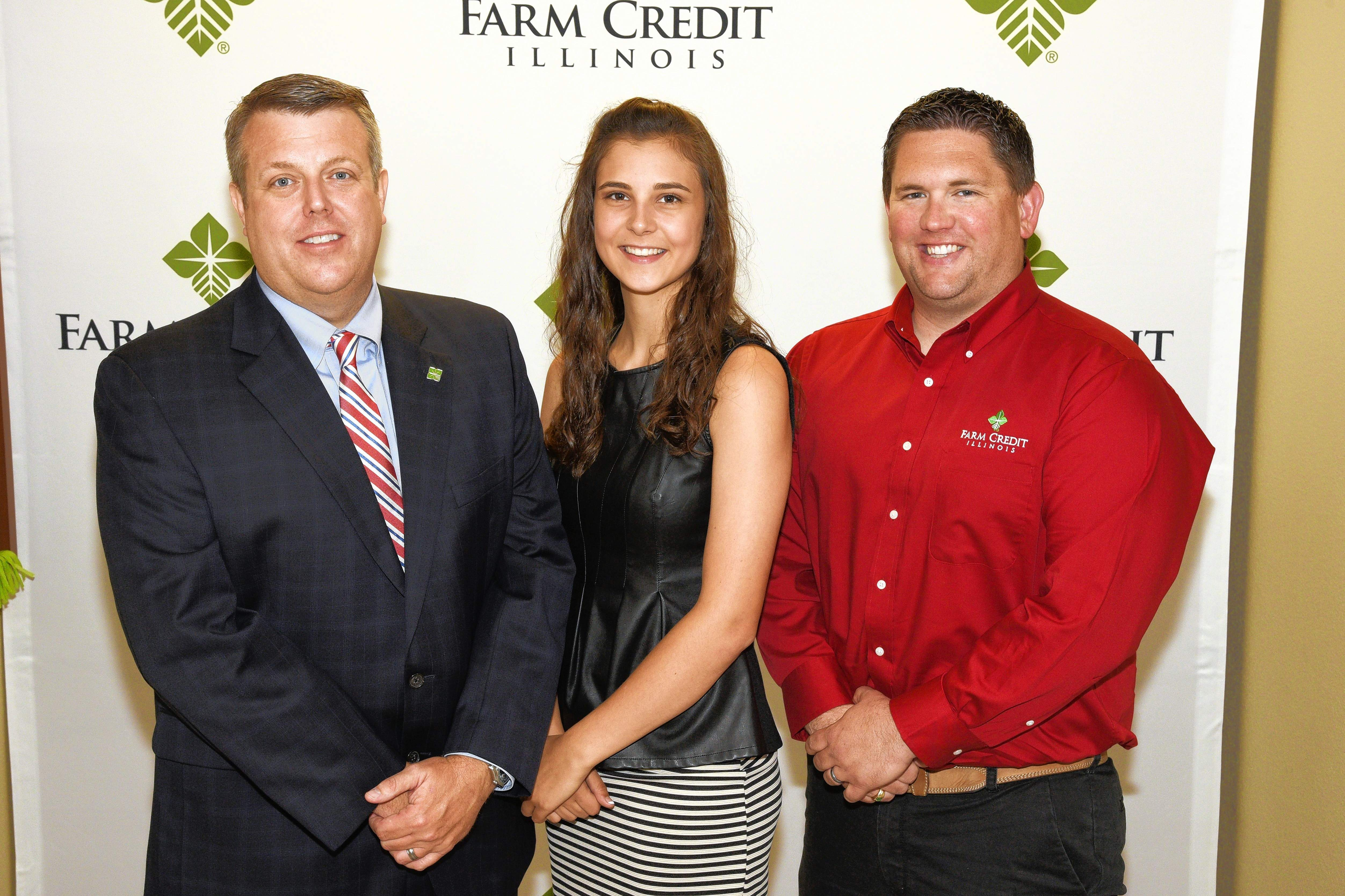 From left, Tom Tracy, Farm Credit Illinois president and CEO, Bridget Payne and Bret Green, FCI Marion regional manager.