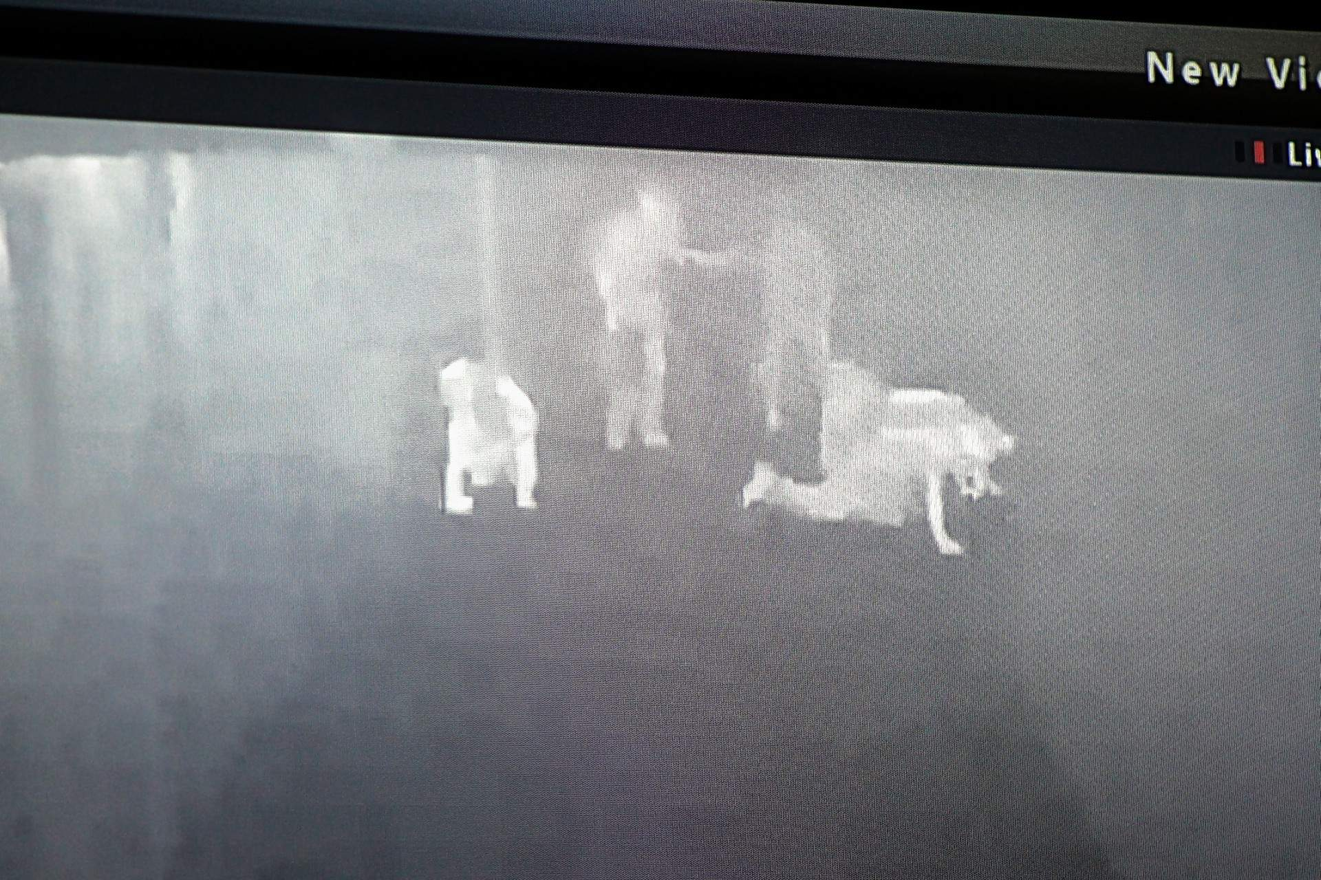 Hamilton County Coal of Dahlgren, the day one winner of the 2017 Mine Rescue and Skills Competition at SIC, is seen on the infrared cameras of the control room, crawling through the smoke-filled simulated mine.