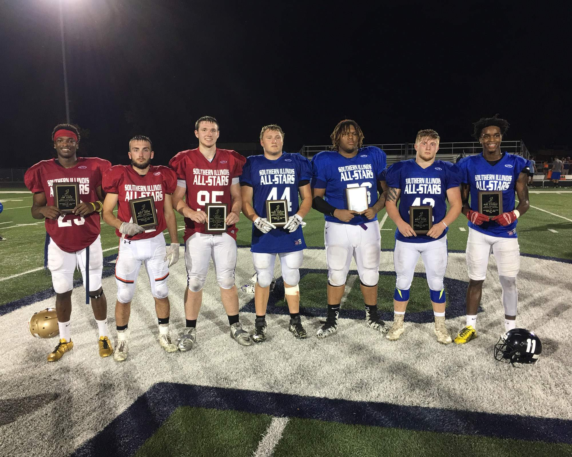 The special award winners at the Southern Illinois All-Star Football Game were (from left): Marion's Jaden Lacy (Jim Lovin Award - Team Red Offensive MVP), Herrin's Kyle Matuszczak (Mike Deck Award - Team Red Defensive MVP), Eldorado's Braden Attebury (Paul Houghton Sportsmanship Award - Team Red), Harrisburg's Jordan Bartok (Gary Glenzy Award - Team Blue Defensive MVP), Harrisburg's Rajah Peacock (Paul Houghton Sportsmanship Award - Team Blue), Anna-Jonesboro's Jayce Turner (Mike Rude Award - Game MVP) and Carbondale's Jaden Bradley (Bob Karnes Award - Team Blue Offensive MVP).