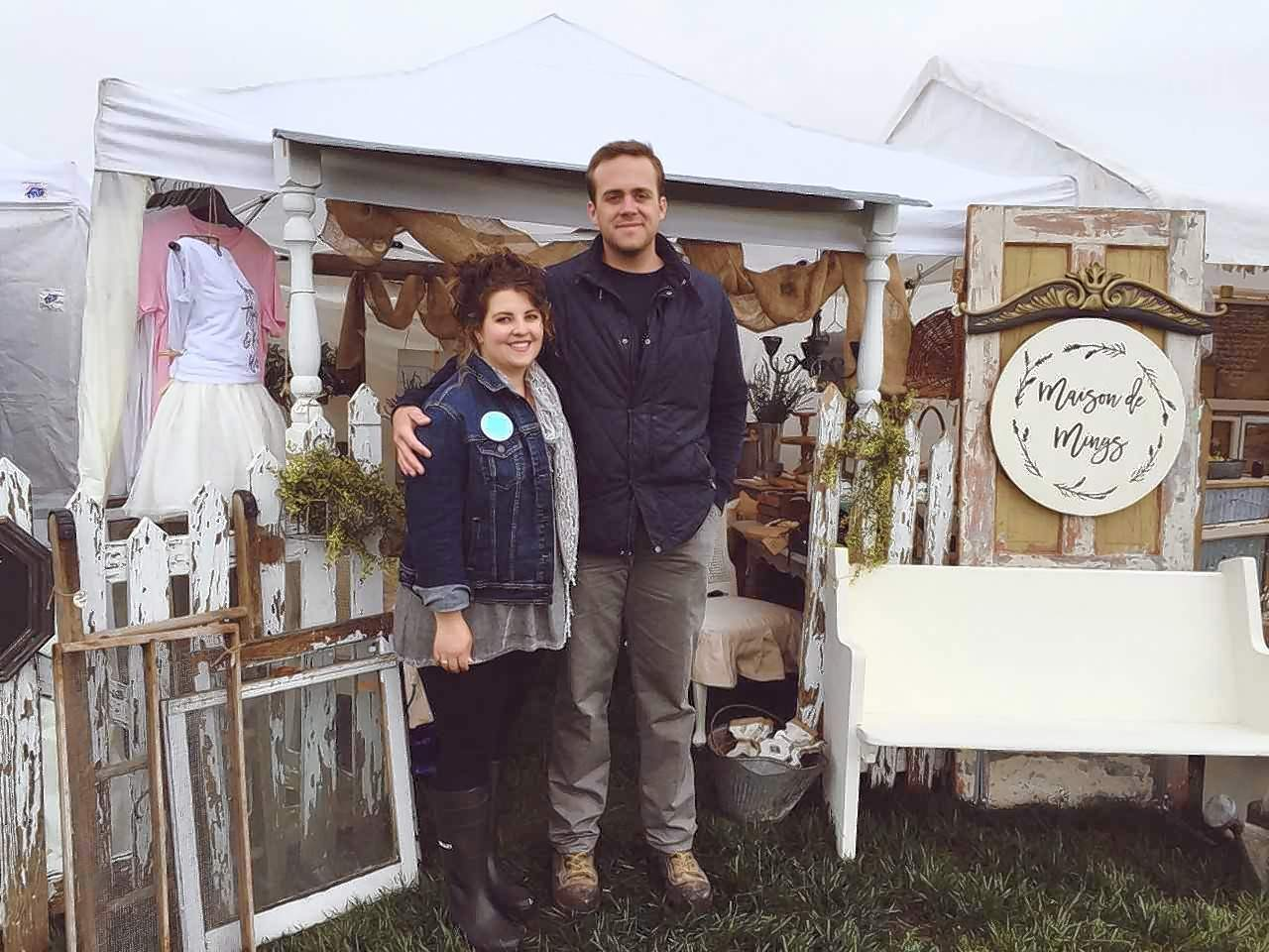 Mat and Amy (Oglesby) Mings stand in front of some of Maison de Mings' inventory.