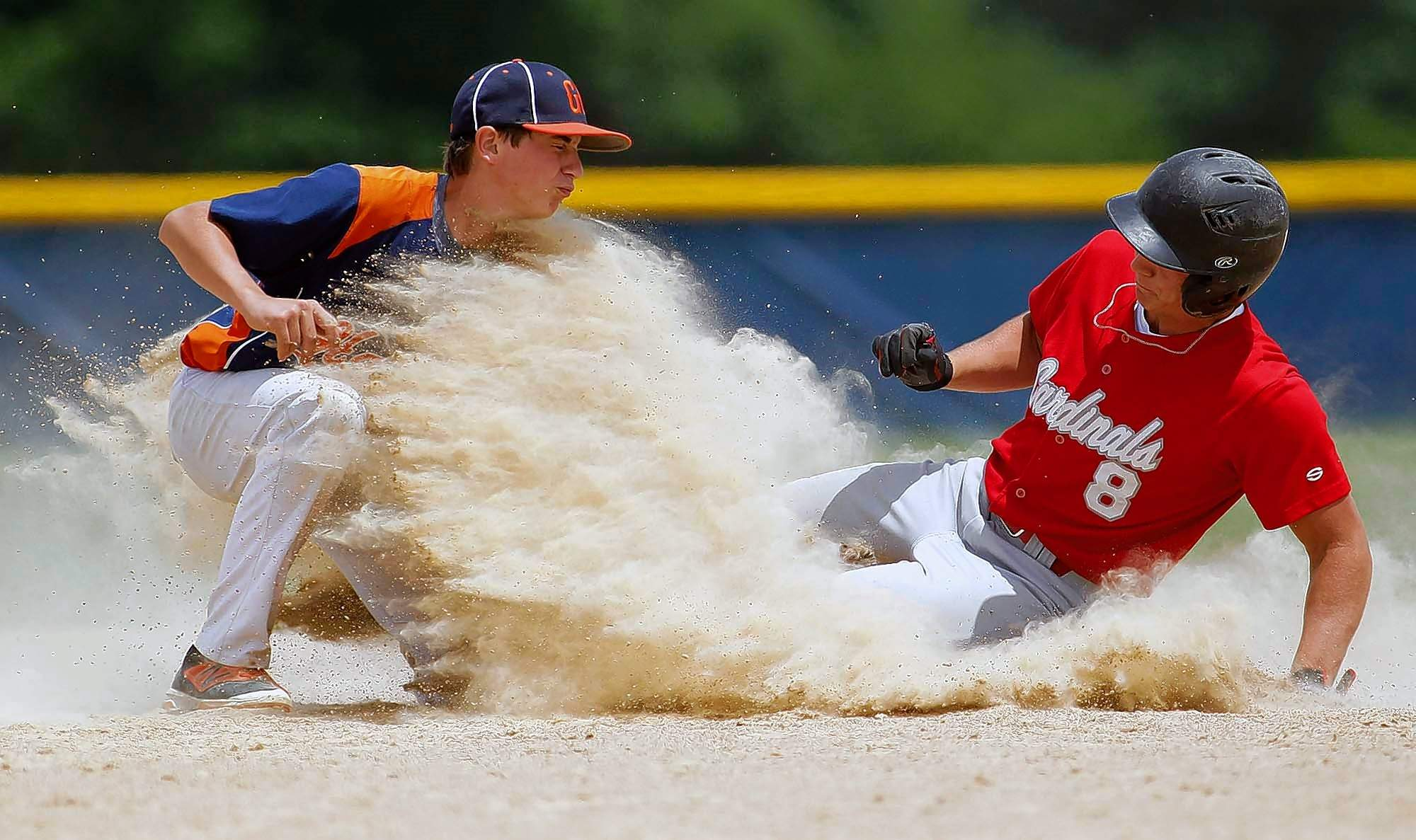 Safe or out? Michael Dann's shot of Grant Bosaw of Gallatin County making the tag on Chase Sutton of Norris City-Omaha-Enfield, won first place in The Associated Press Division I photo contest.