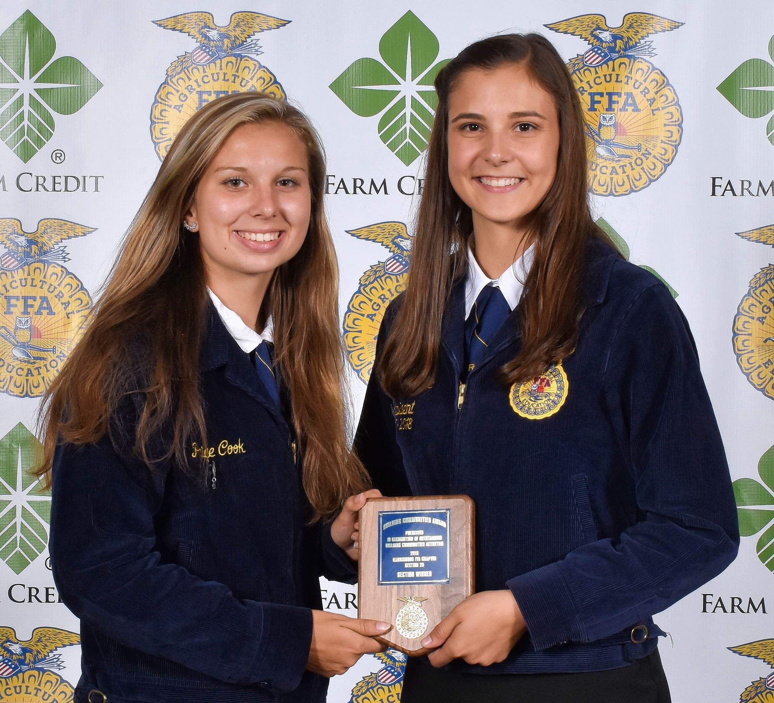 Paige Cook, left, and Bridget Payne with the Building Communities National Chapter Section Award. As part of the National Chapter Award program and the chapter's program of activities, Building Communities is designed to encourage the local development of FFA partnerships with alumni affiliates and other organizations while taking a leadership role in making the community a better place to live and work.