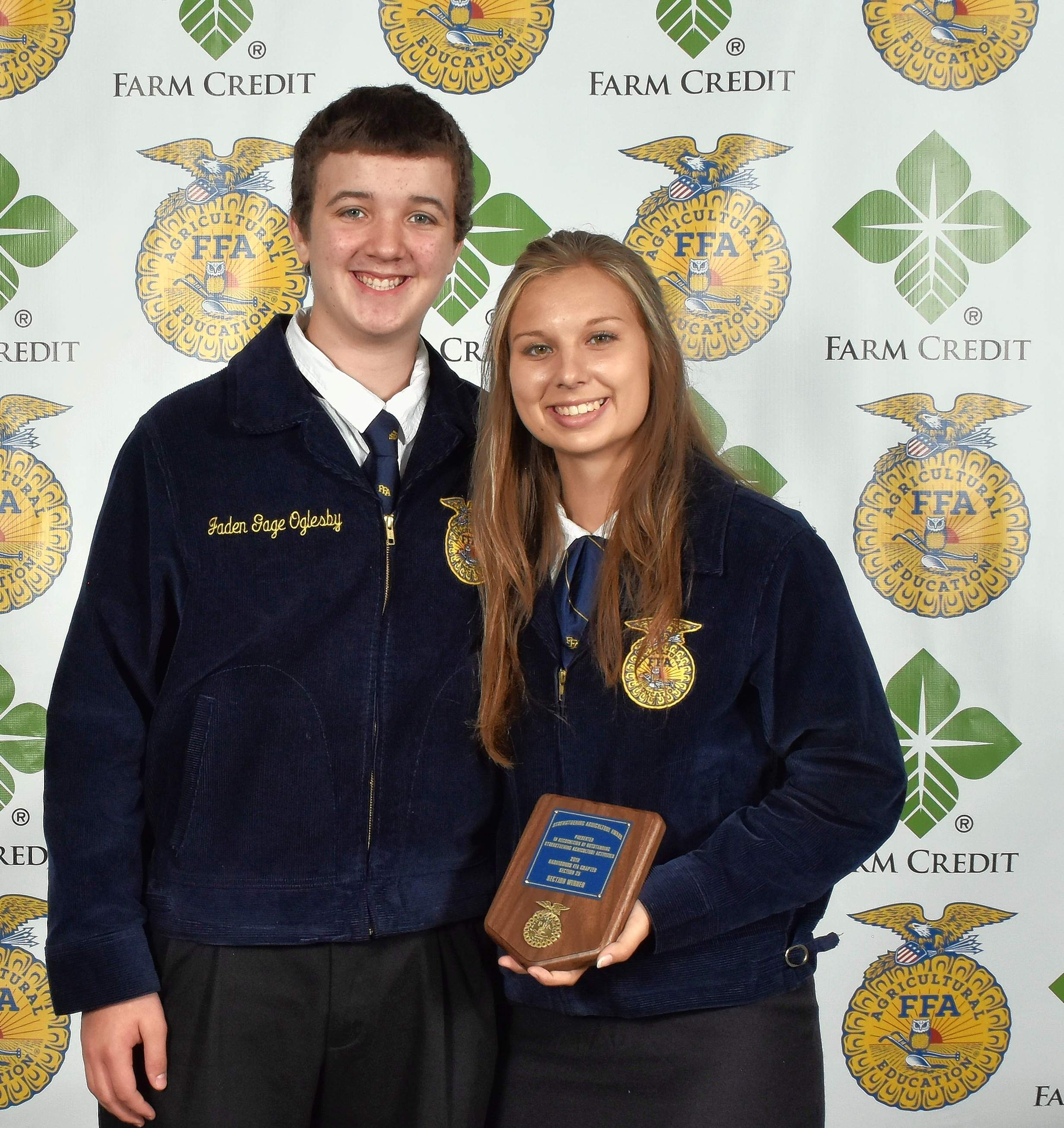 Paige Cook, right, and Jaden Oglesby with the Strengthening Agriculture National Chapter Section Award. As part of the National Chapter Award program and the chapter's program of activities, Strengthening Agriculture is designed to encourage opportunities and service for members, such as promoting increased member participation and financial responsibility, creating a positive image, and interacting with support groups and cooperatives through organized activities.
