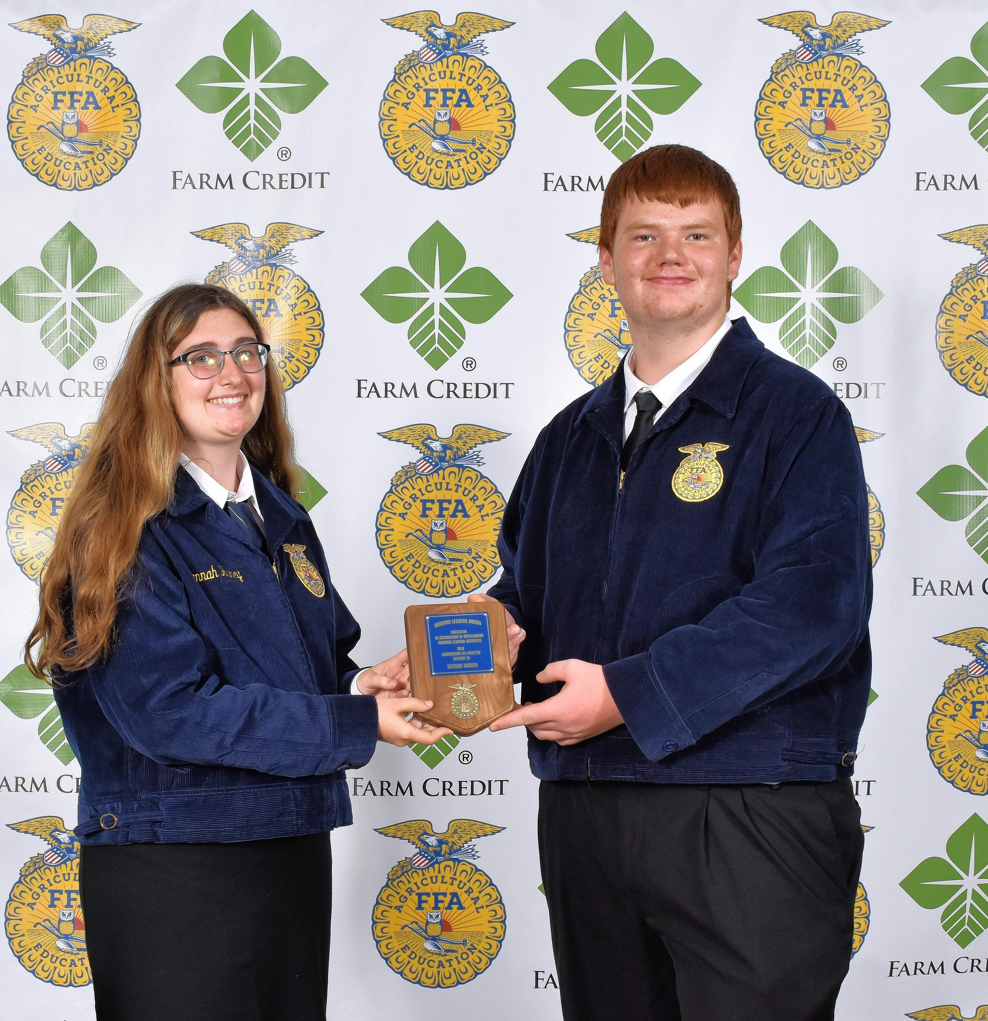 Hannah Haney, left, and Riley Harper with the Growing Leaders National Chapter Section Award. As part of the National Chapter Award program and the chapter's program of activities, Growing Leaders is designed to encourage the chapter to develop individual and cooperative activities to enhance students' life skills.