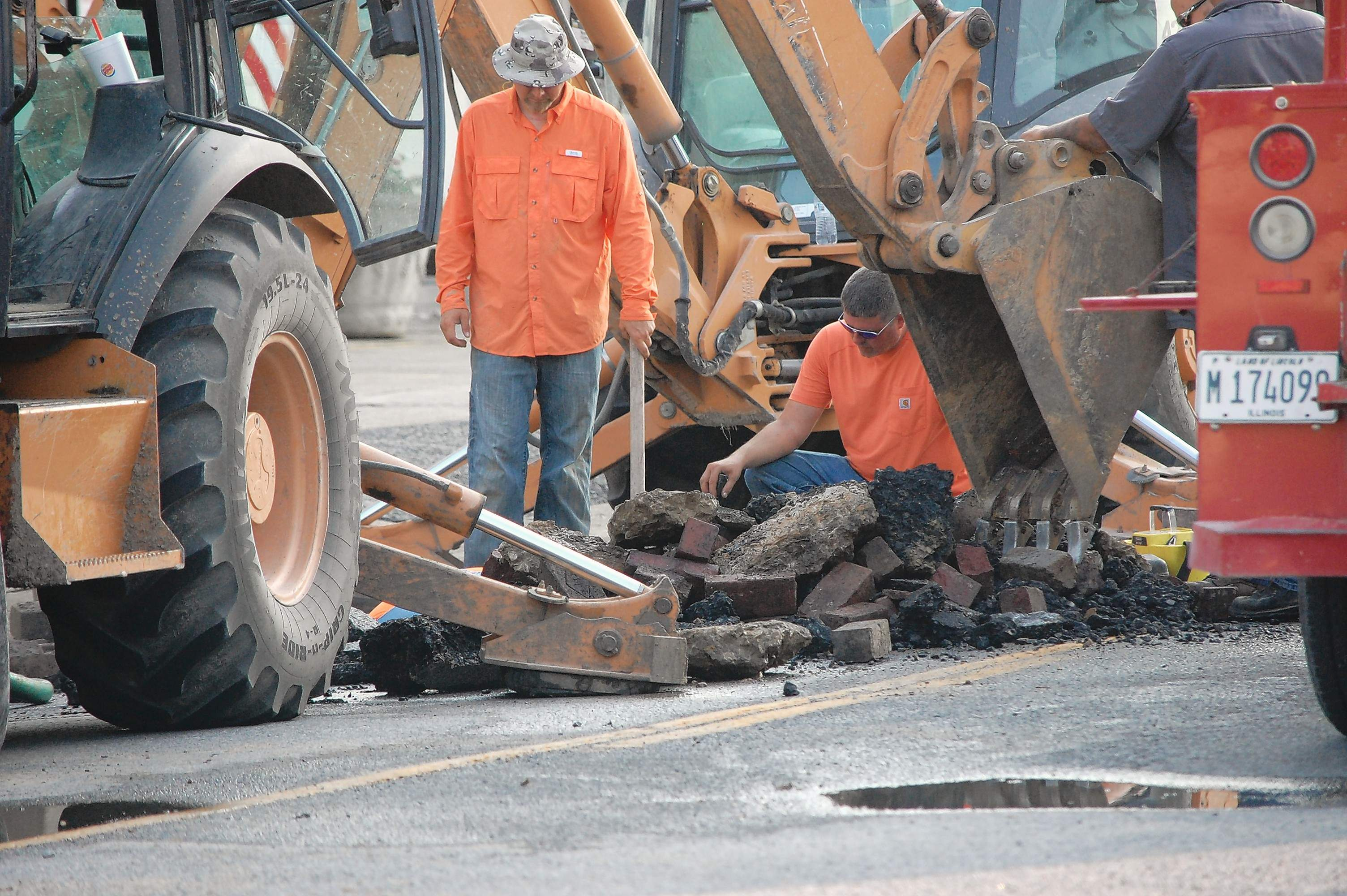 The water main break on Poplar Street Sunday afternoon in Harrisburg required digging through pavement and the underlying brick street to reach the break.