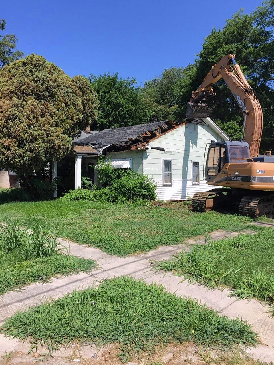 A house on South Raymond Street in Harrisburg is torn down by city workers on Monday, one of two houses demolished in the city's effort to tear down dangerous, derelict homes. McPeek said 18 more will be torn down in Harrisburg this year.