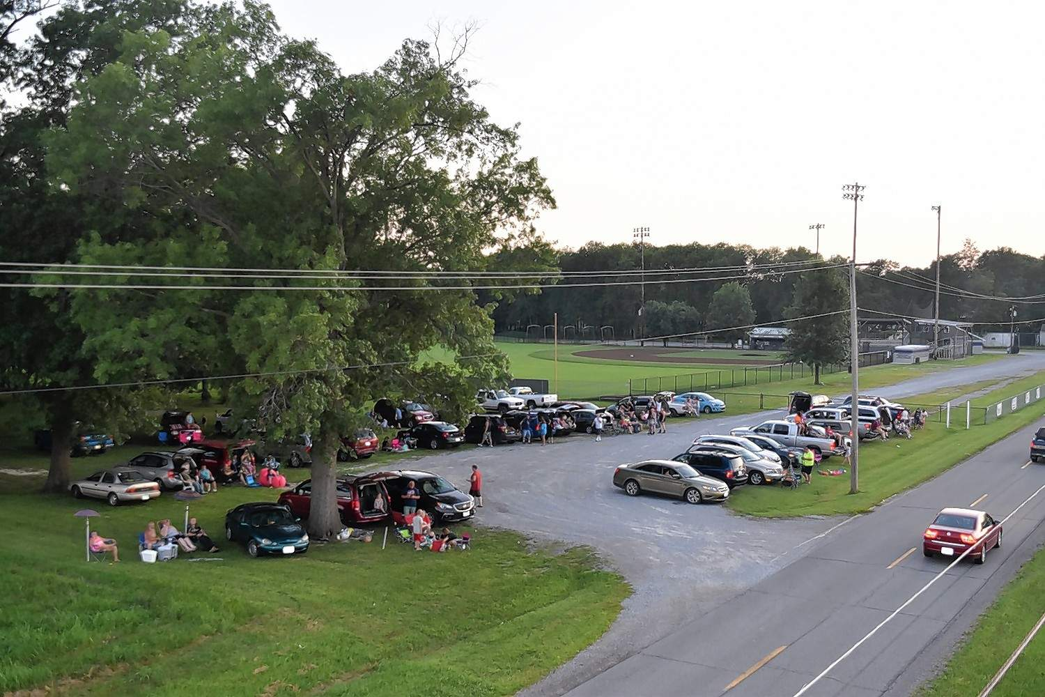 Cars full of people arrive for the Harrisburg Fourth of July fireworks and veterans appreciation, on Wednesday evening.