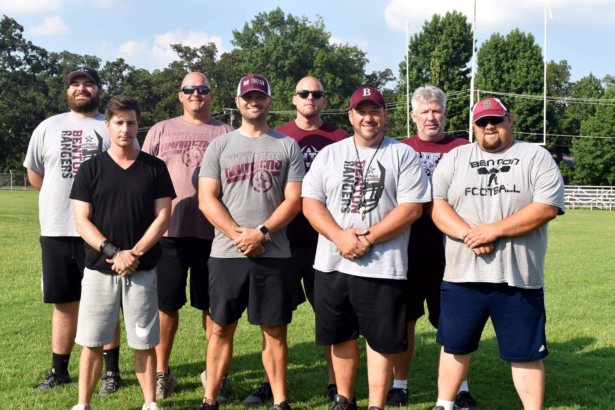Benton High School's football coaches for 2018 includes, from left: Austin Dickson, Aron Kays, Casey McCommons, Aaron Webb, Brent Johnson, Justin Groves, Troy Knight and Josh Kinsman. Absent for the photo were Matt Brown, Robin Labuwi and volunteer coach Andy Sloan.