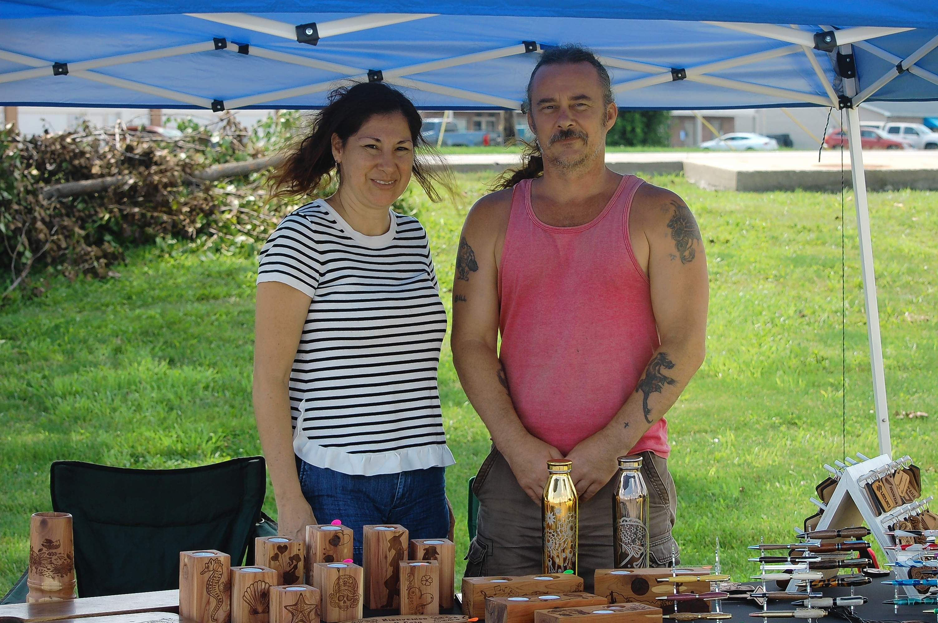 Bill Dunstan of Golconda and Maggie Muniz, originally from Puerto Rico, display some of their woodcraft items for sale.