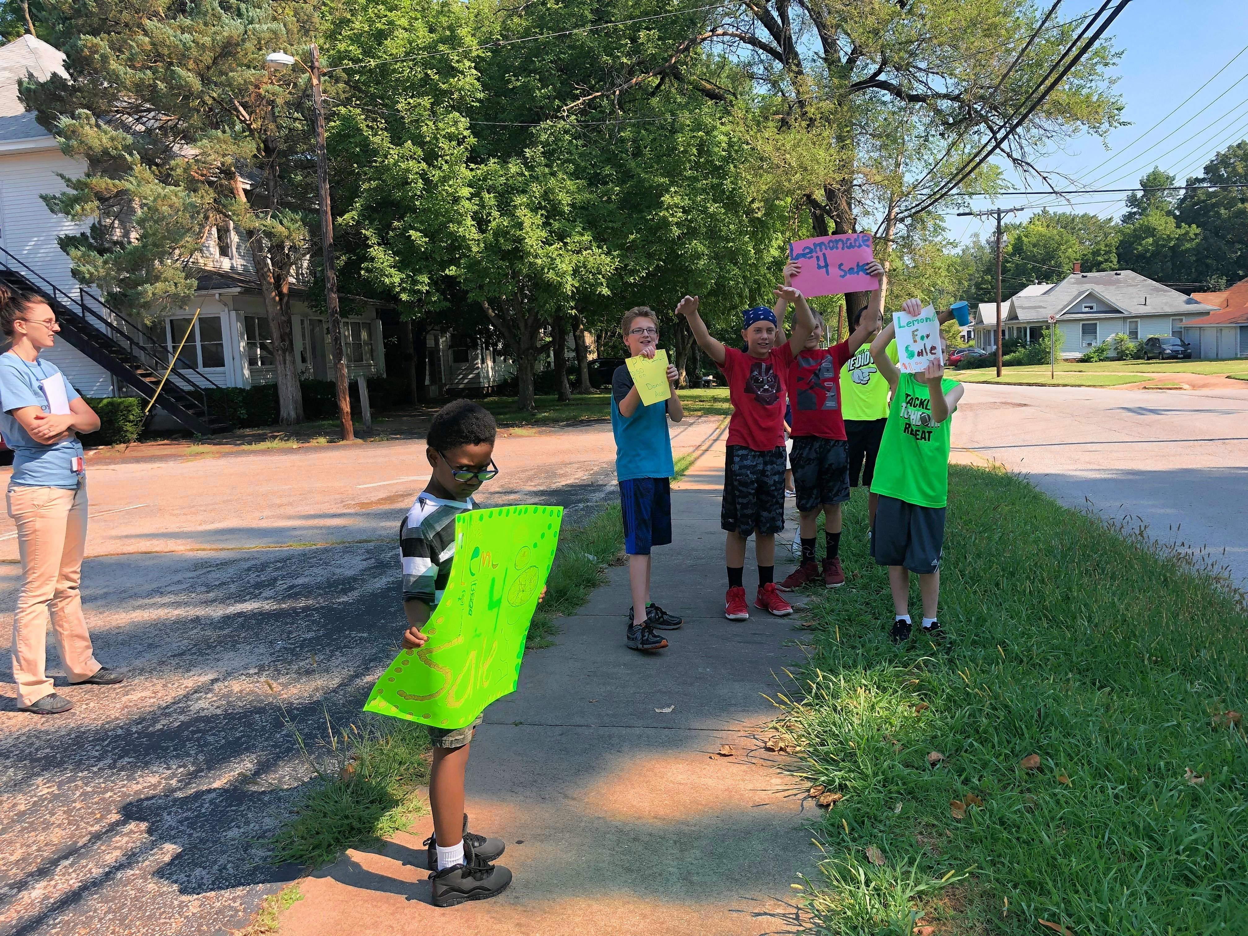 Attracting customers was part of the learning experience for members of the Boys and Girls Club of Carbondale at Tuesday's lemonade sale.