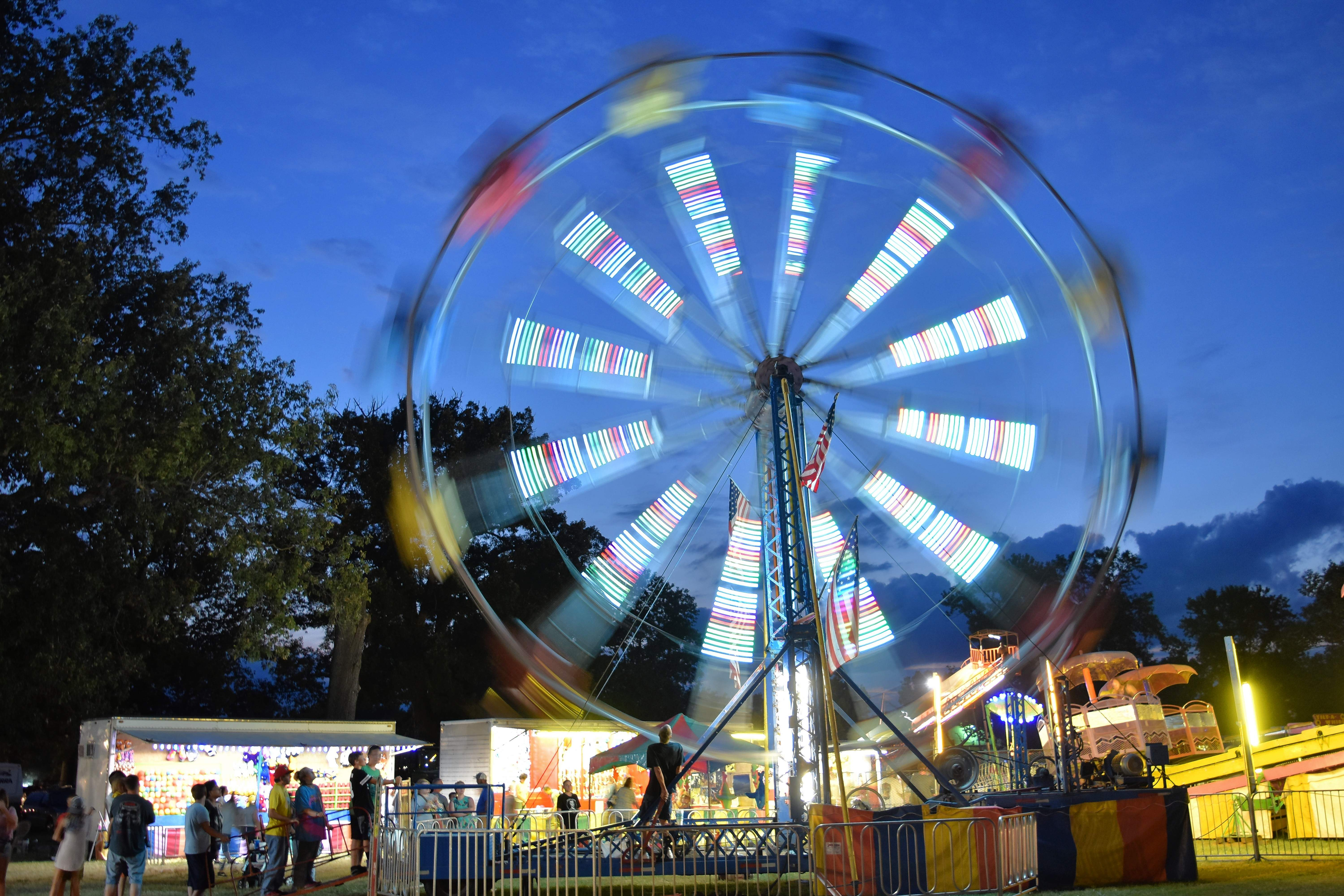 The Ferris wheel spins Saturday night at the Saline County Fair.