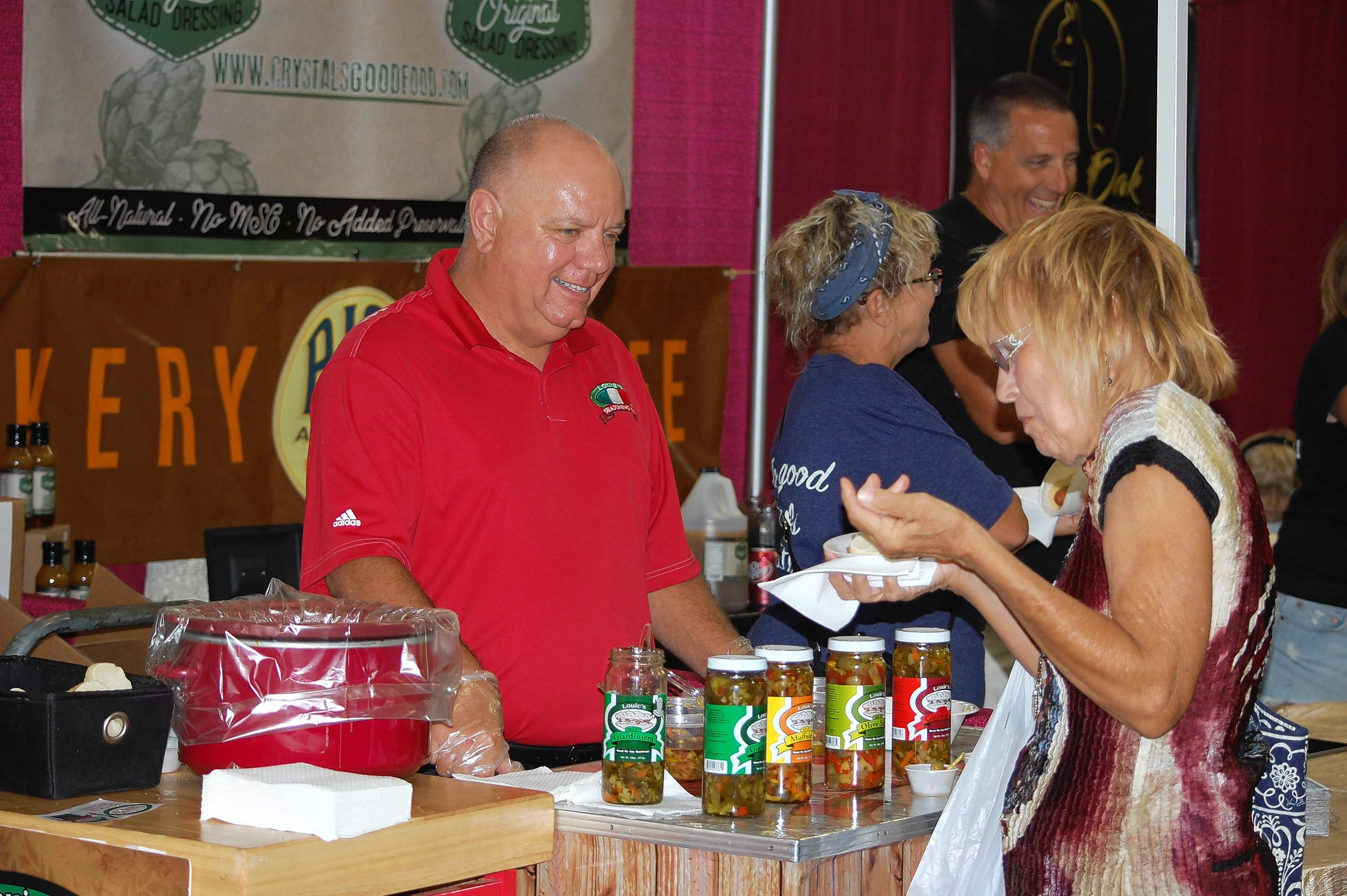 Chris Gualdoni, left, of Louis' Seasonings, gives an Italian beef sample to Judy Fix, who was attending the Southern Illinois Made Expo Saturday.
