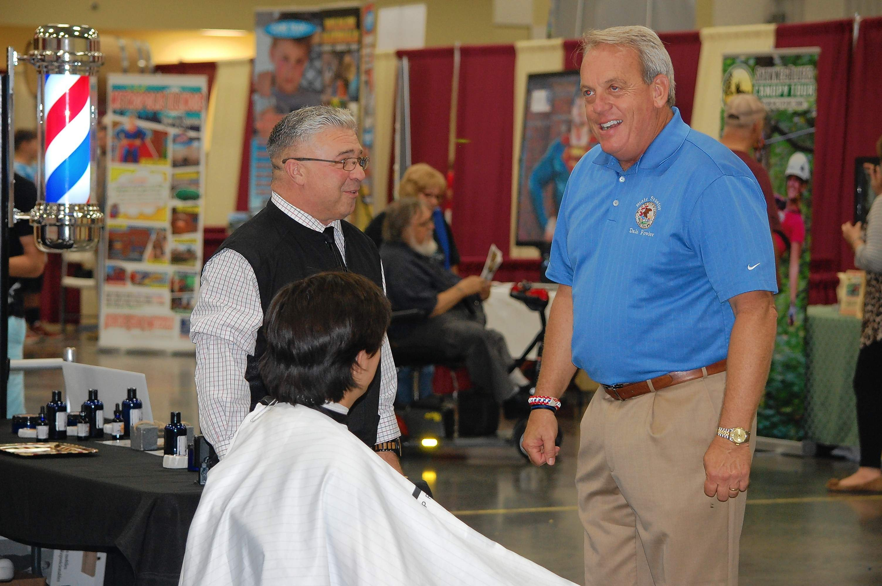 State Sen. Dale Fowler, R-Harrisburg, talks to a barber and patron Saturday at the Southern Illinois Made Expo.